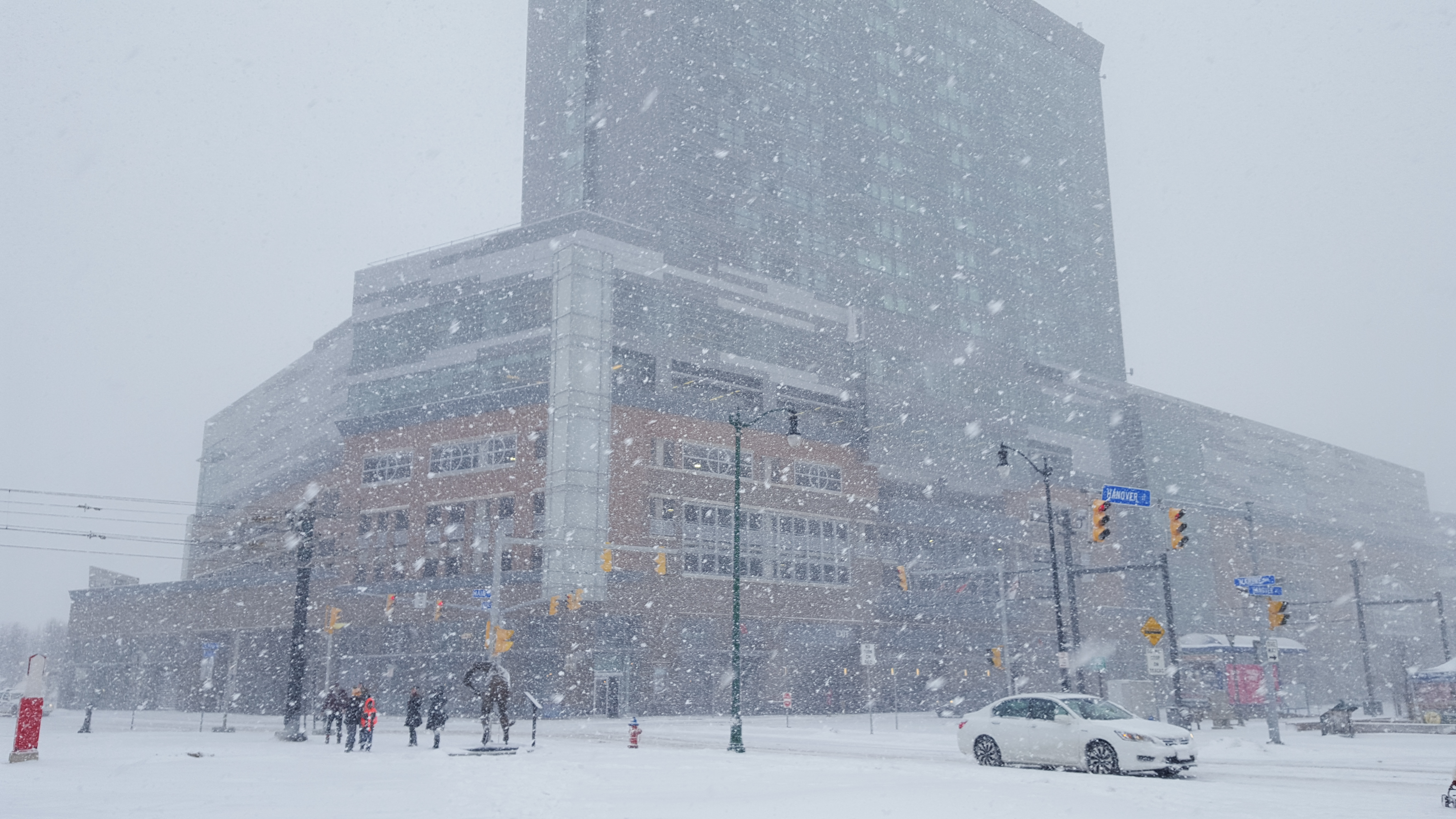 Snow falls in front of HarborCenter shortly after 2 p.m. Jan. 17. (Sara Meehan/Buffalo News)