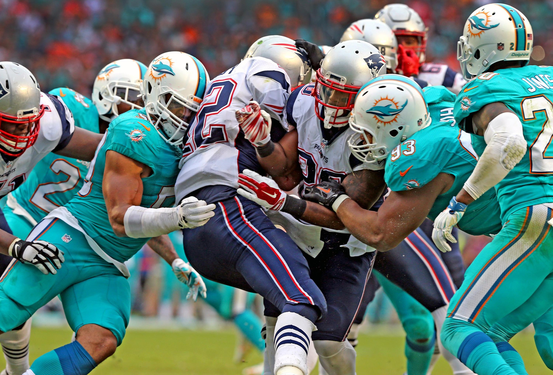 The Miami Dolphins defensive line sacks New England Patriots quarterback Tom Brady during the fourth quarter Sunday at Sun Life Stadium in Miami Gardens, Fla.