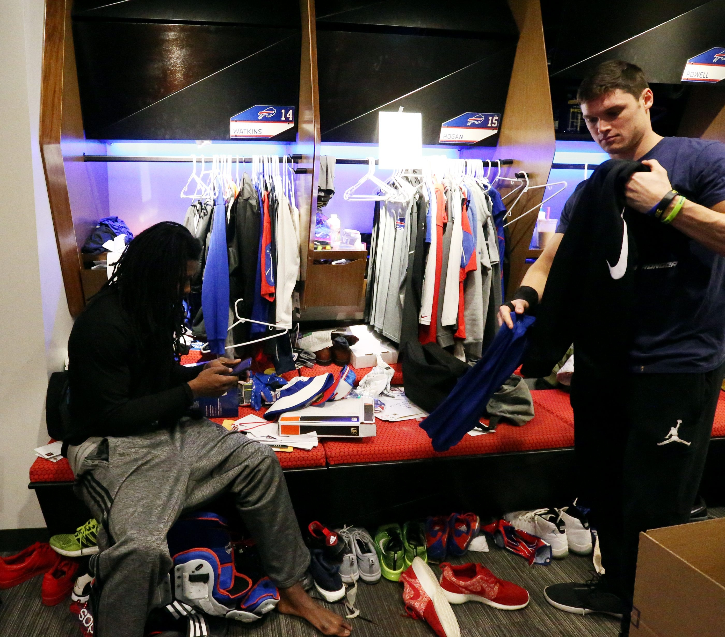 Buffalo Bills wide receiver Chris Hogan (15) packs up his clothes and equipment during the season-end locker-room cleanout.