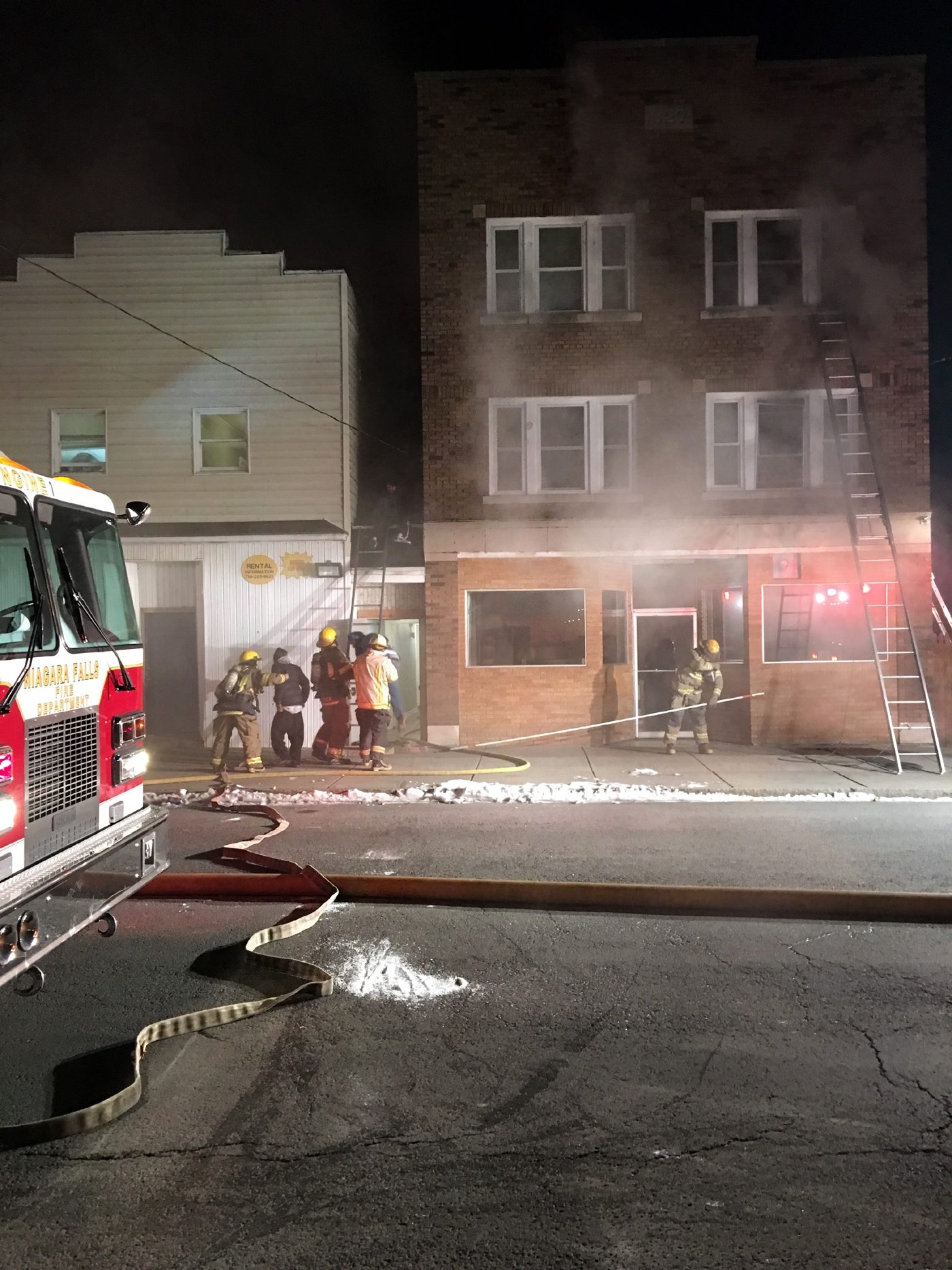 Firefighters in Niagara Falls used ladder trucks to rescue several people from a rooming house on Niagara Street that caught on fire. More than 20 residents were left homeless.