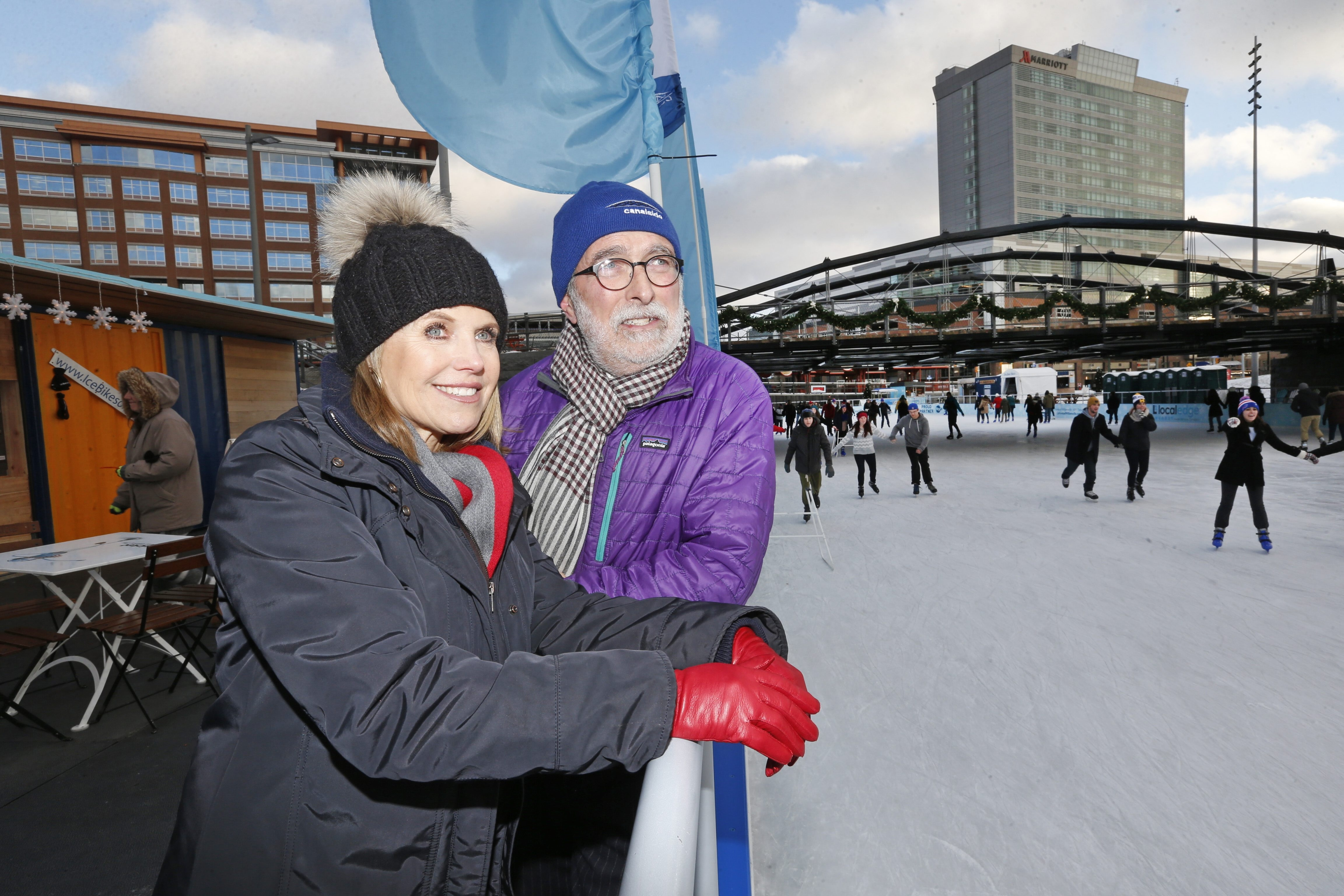 Katie Couric got a tour of the ice rink from Robert Gioia, chairman of Erie County Harbor Development Corp., with her new Buffalo hat at Canalside in Buffalo on Tuesday.