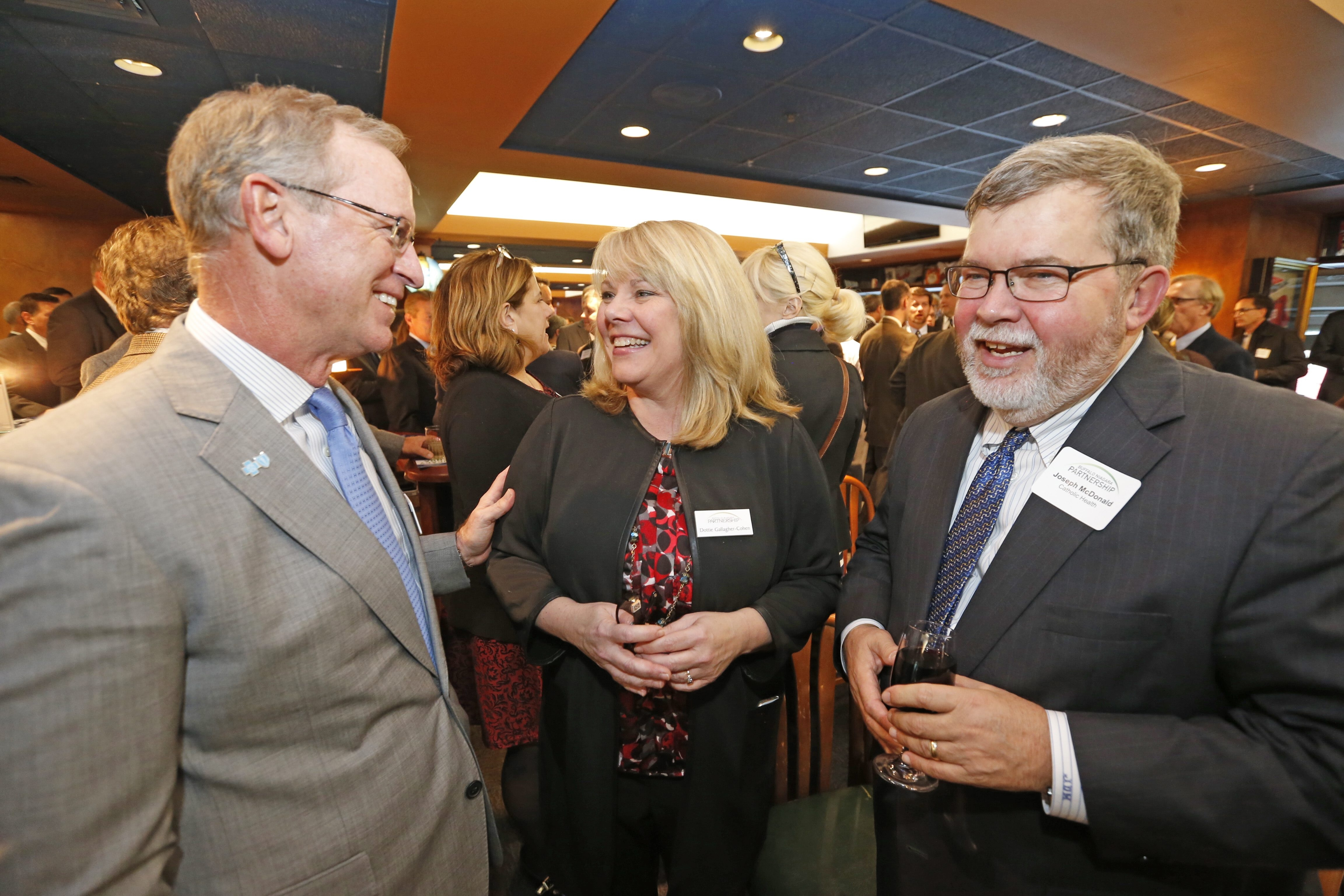 Partnership President Dottie Gallagher-Cohen chats with BlueCross BlueShield's David W. Anderson, left, and Catholic Health's Joseph D. McDonald at event.