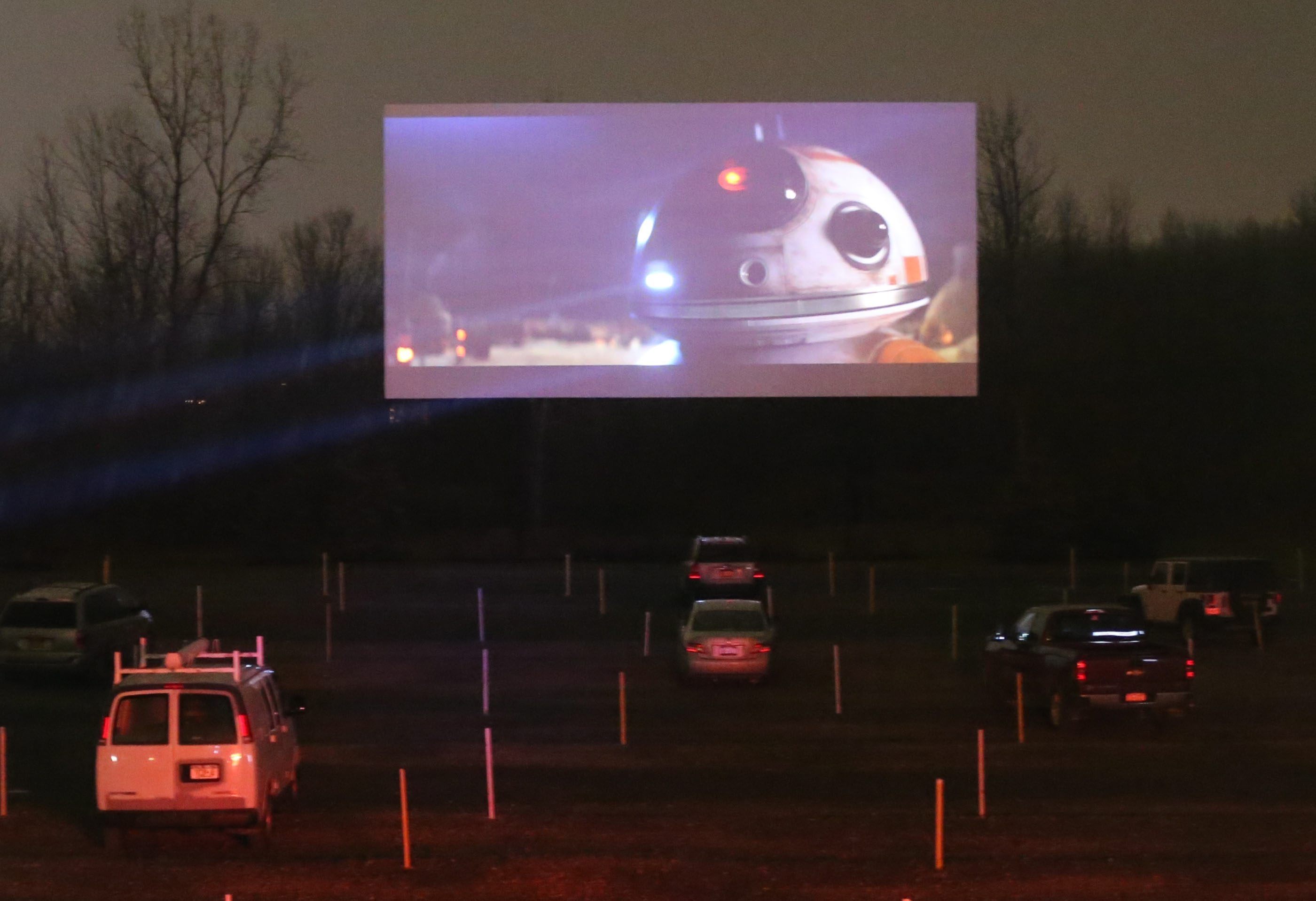 "The rain and the cold could not keep moviegoers from attending a night at the movies to see ""Star Wars: The Force Awakens"" at the Transit Drive-In Friday night in Lockport. (James P. McCoy/Buffalo News)"