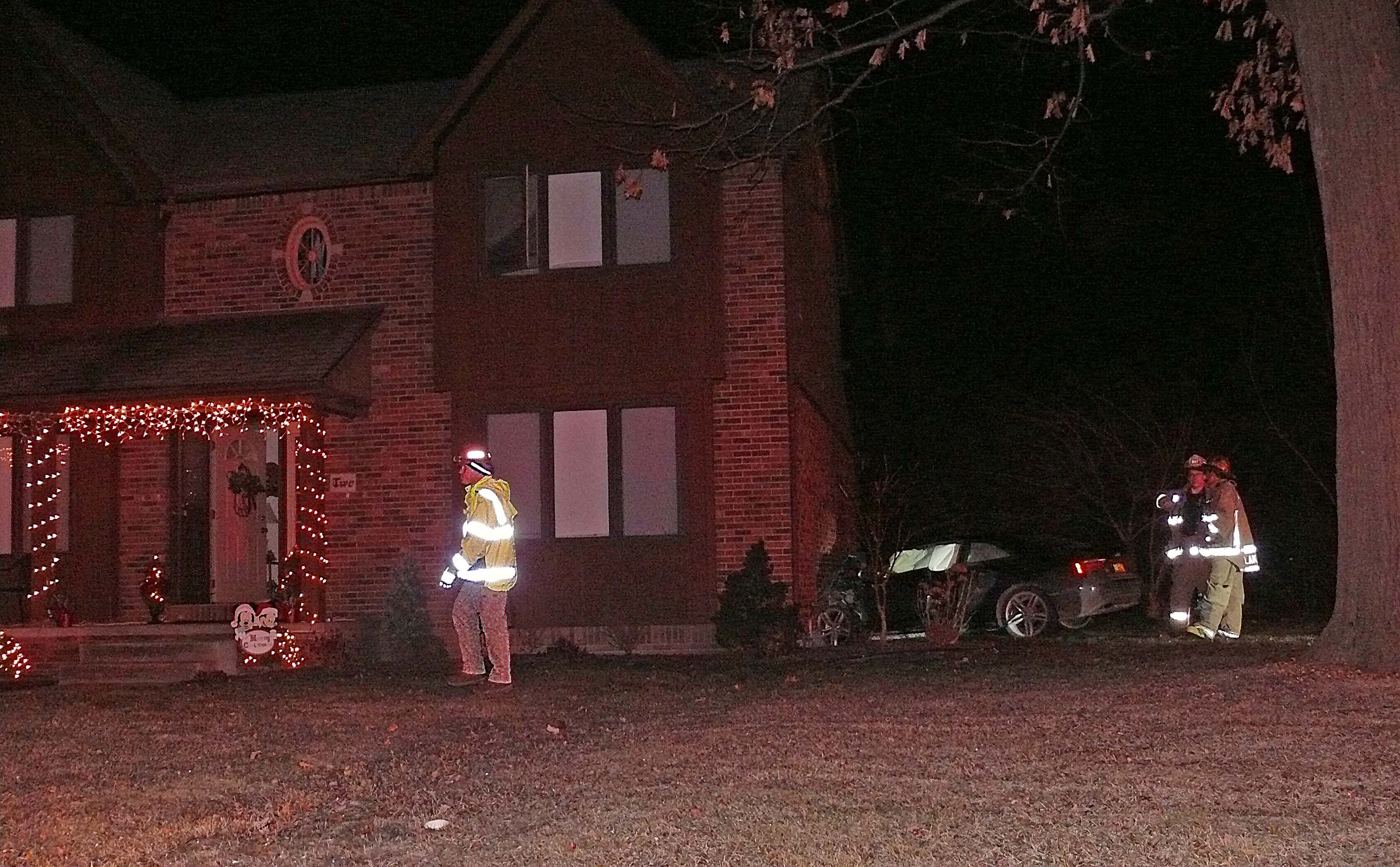 Emergency personnel at the scene where a car crashed into 2 Nottingham Terrace early Friday. (Joanne McNamara/Special to The News)