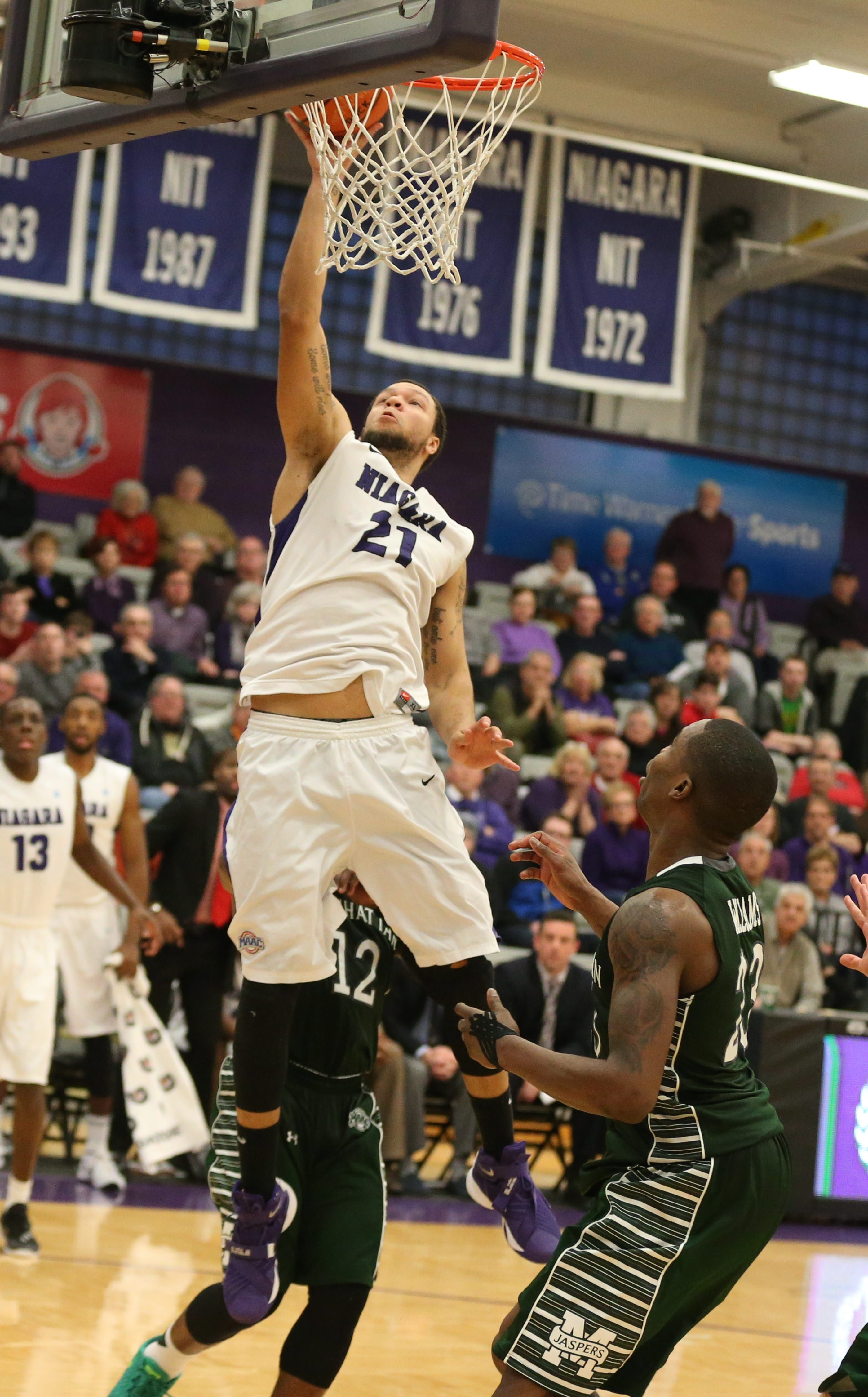Niagara University forward Justin Satchell scores the game-winning basket on a tip-in with 1.2 seconds left to beat Manhattan College on Saturday.
