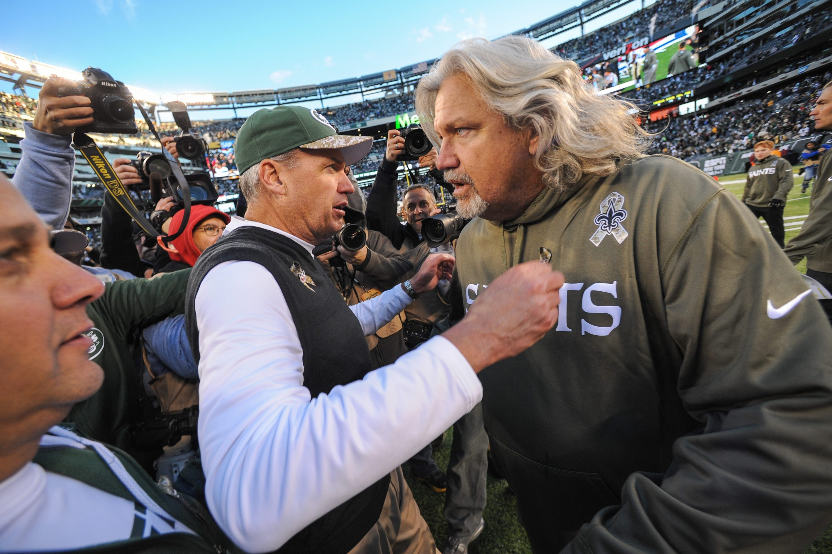 Rex Ryan, left, will be working with his brother Rob after hiring his twin to be assistant head coach/defense for the Bills. (Getty Images)