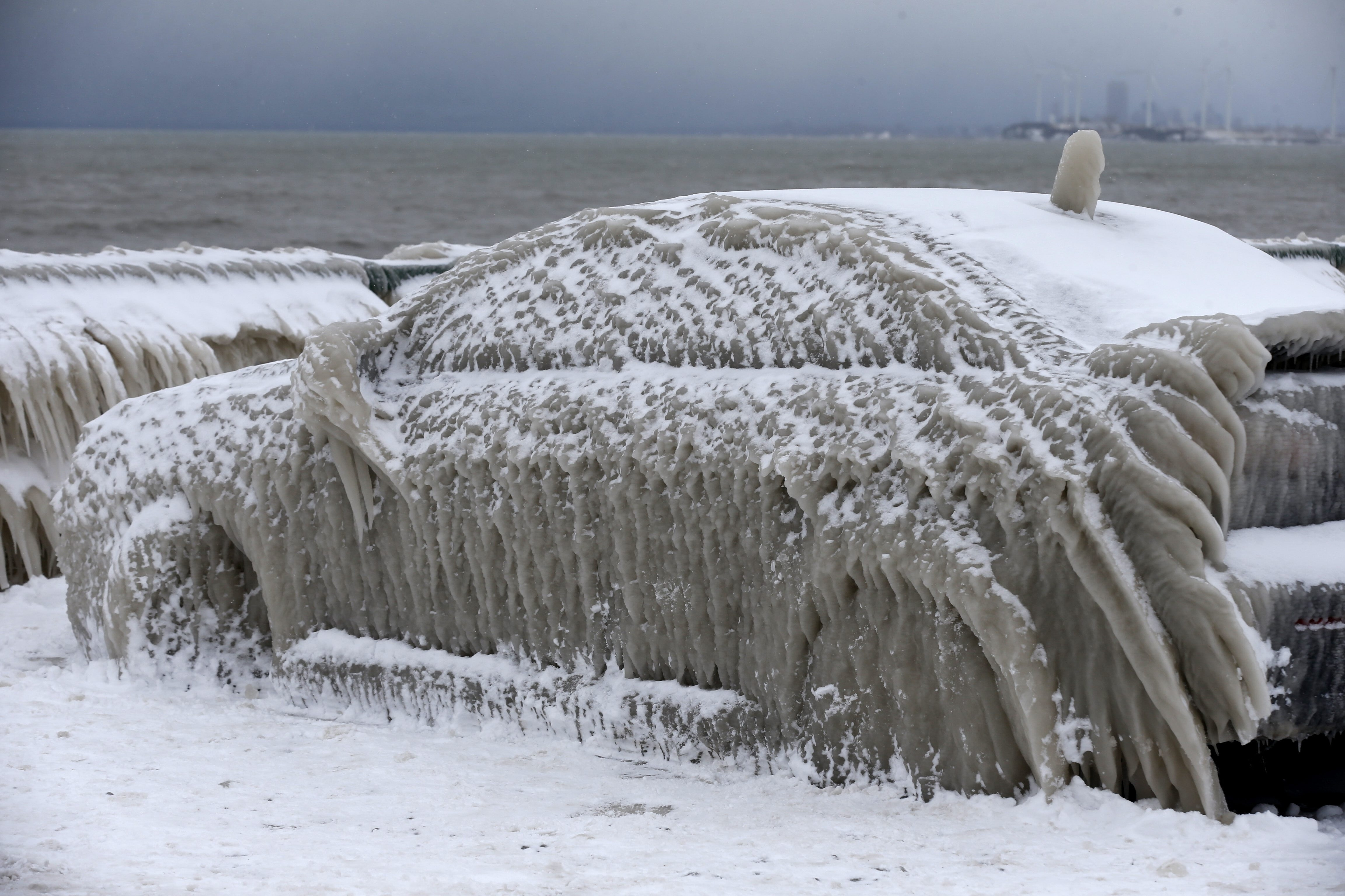 The now-famous frozen car remains trapped by ice Tuesday in Hamburg, in Hoak's parking lot next to Lake Erie.