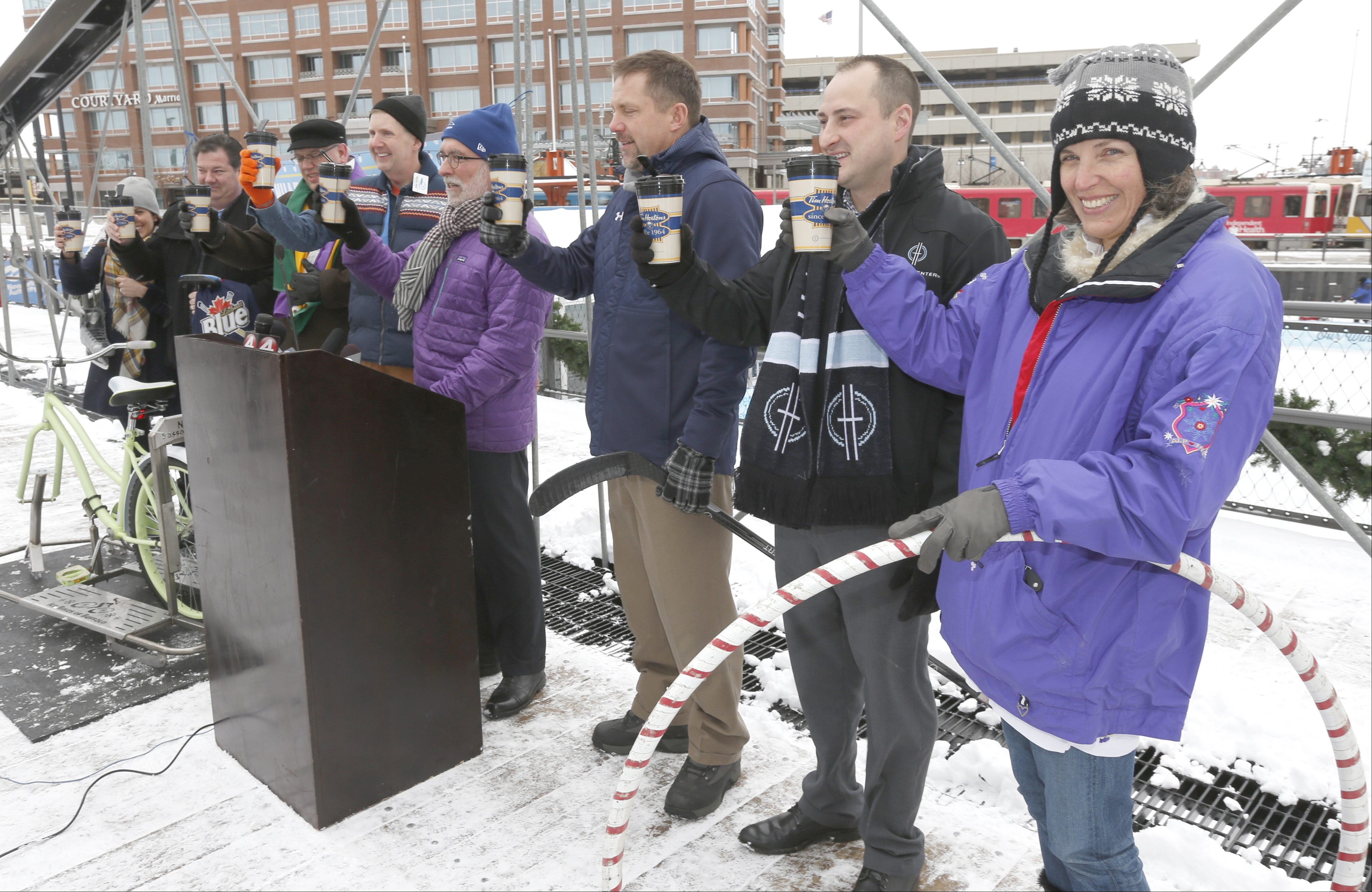 Traditional toast of Hot Chocolate. Erie canal Harbor Development Corporation Chairman Robert Gioia, at podium, announces a vast list of winter time activities to be had at, and around CanalSide, at a press conference on a bridge near the rink in Buffalo on Tuesday, Jan. 12, 2016.  (Robert Kirkham/Buffalo News)