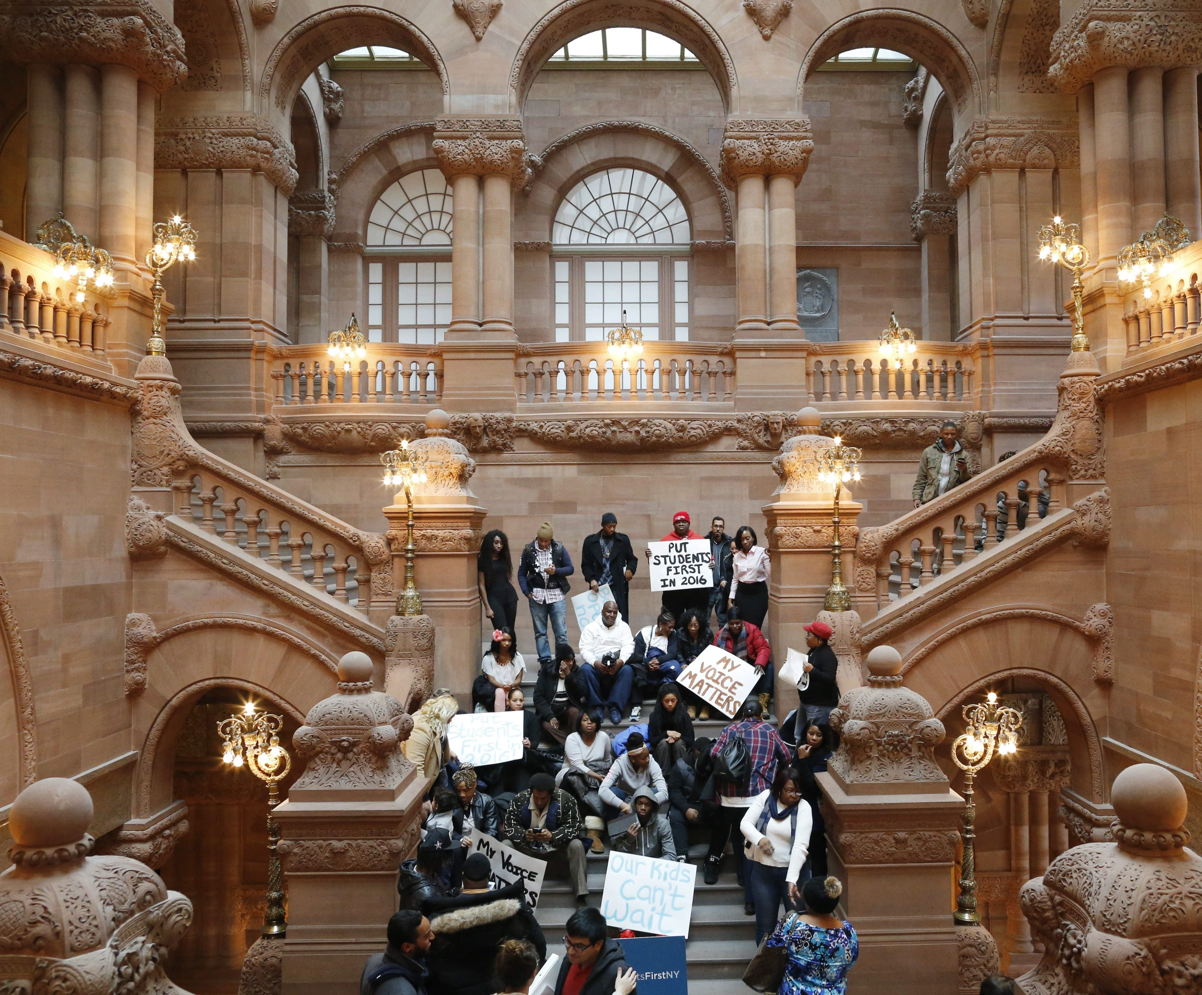 """On the eve of the governor's State of the State address, the advocacy group Students First NY holds a rally on the """"Million Dollar Staircase"""" in the State Capitol in an effort to put education issues in the spotlight."""