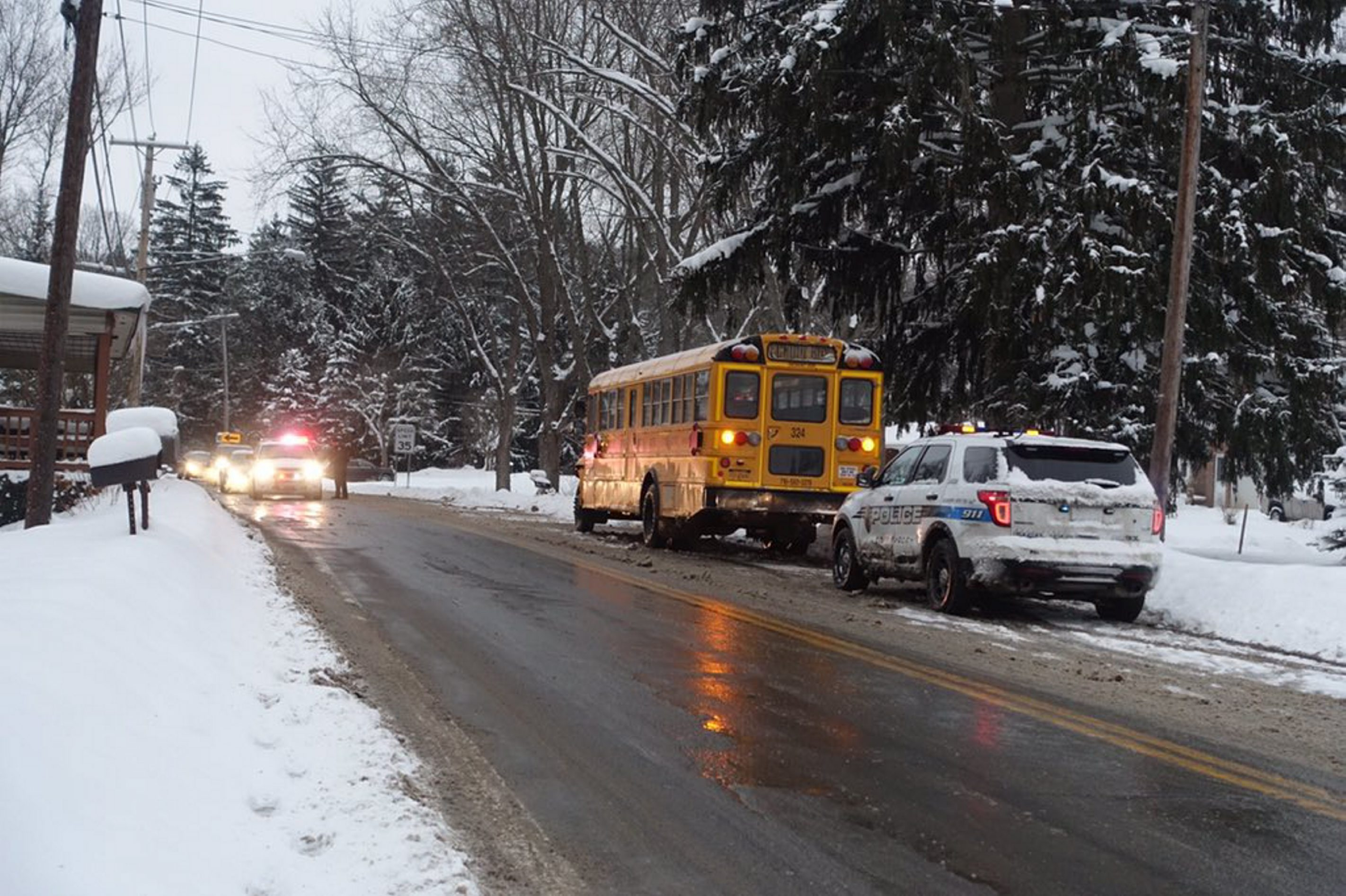 None of the eight students aboard Springville-Griffith school bus were injured in a weather-related collision Thursday morning in West Falls. (John Hickey/Buffalo News)
