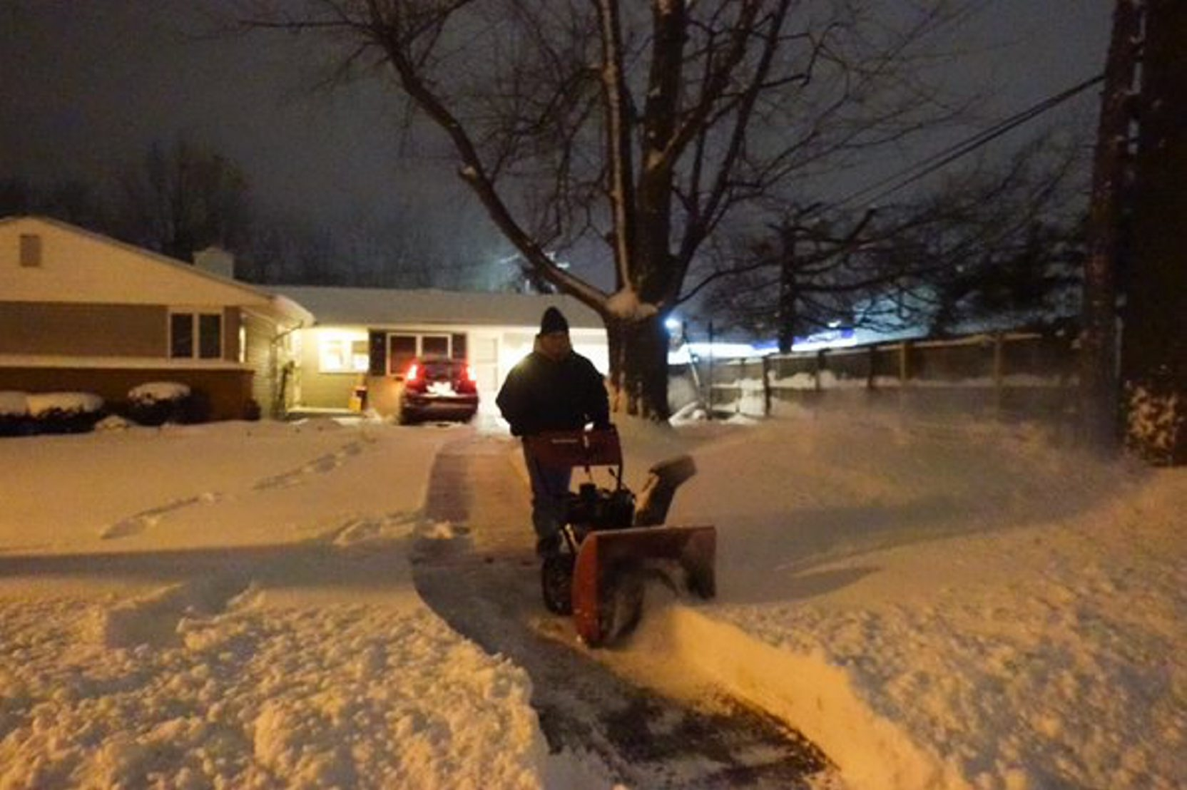 Mike Argentieri clears his driveway this morning in the Town of Tonawanda after a snowfall left  6 to 8 inches of snow overnight. (John Hickey/Buffalo News)