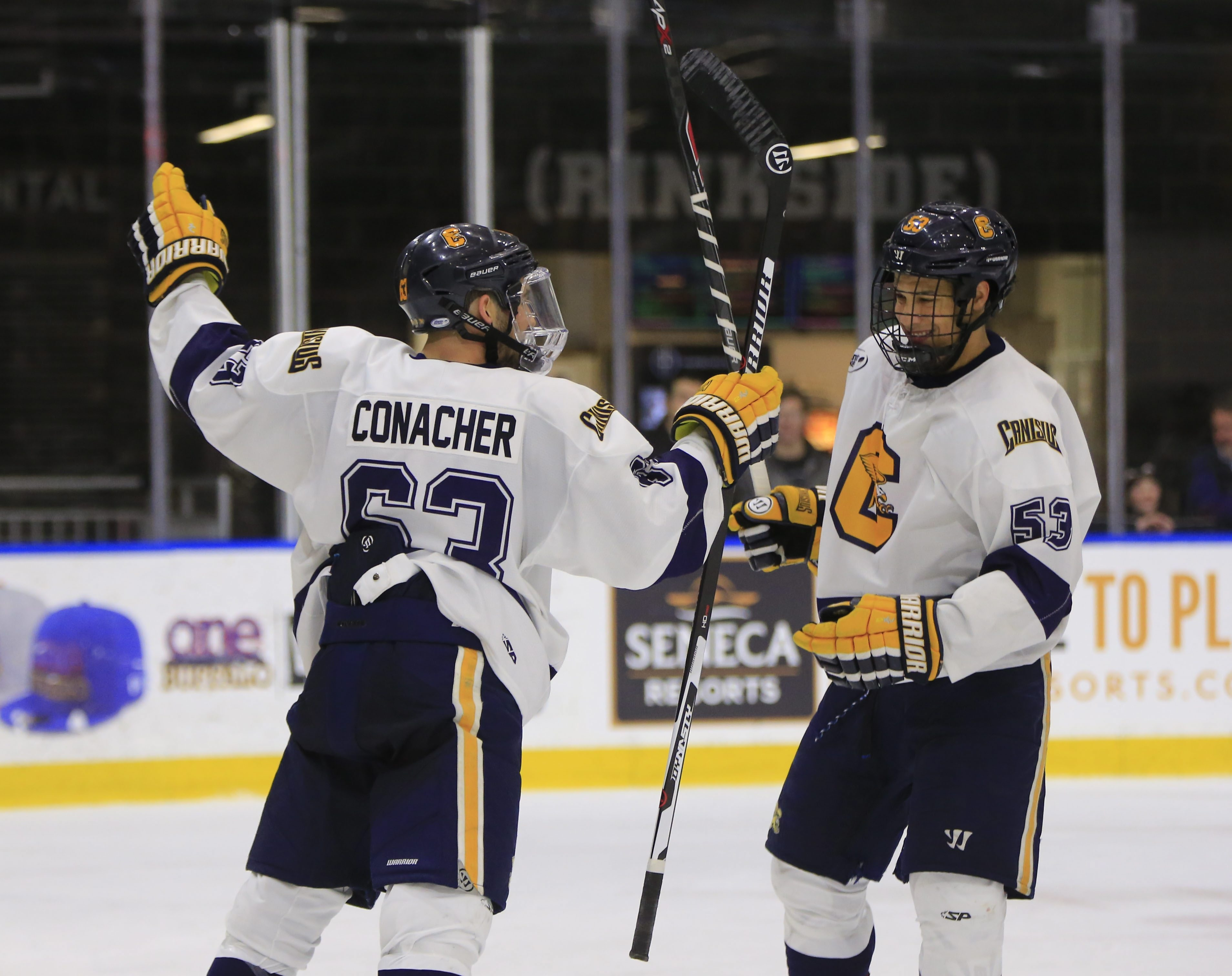 Shane Conacher of Canisius celebrates his goal with Cameron Heath in the third period against Niagara on Thursday at HarborCenter.