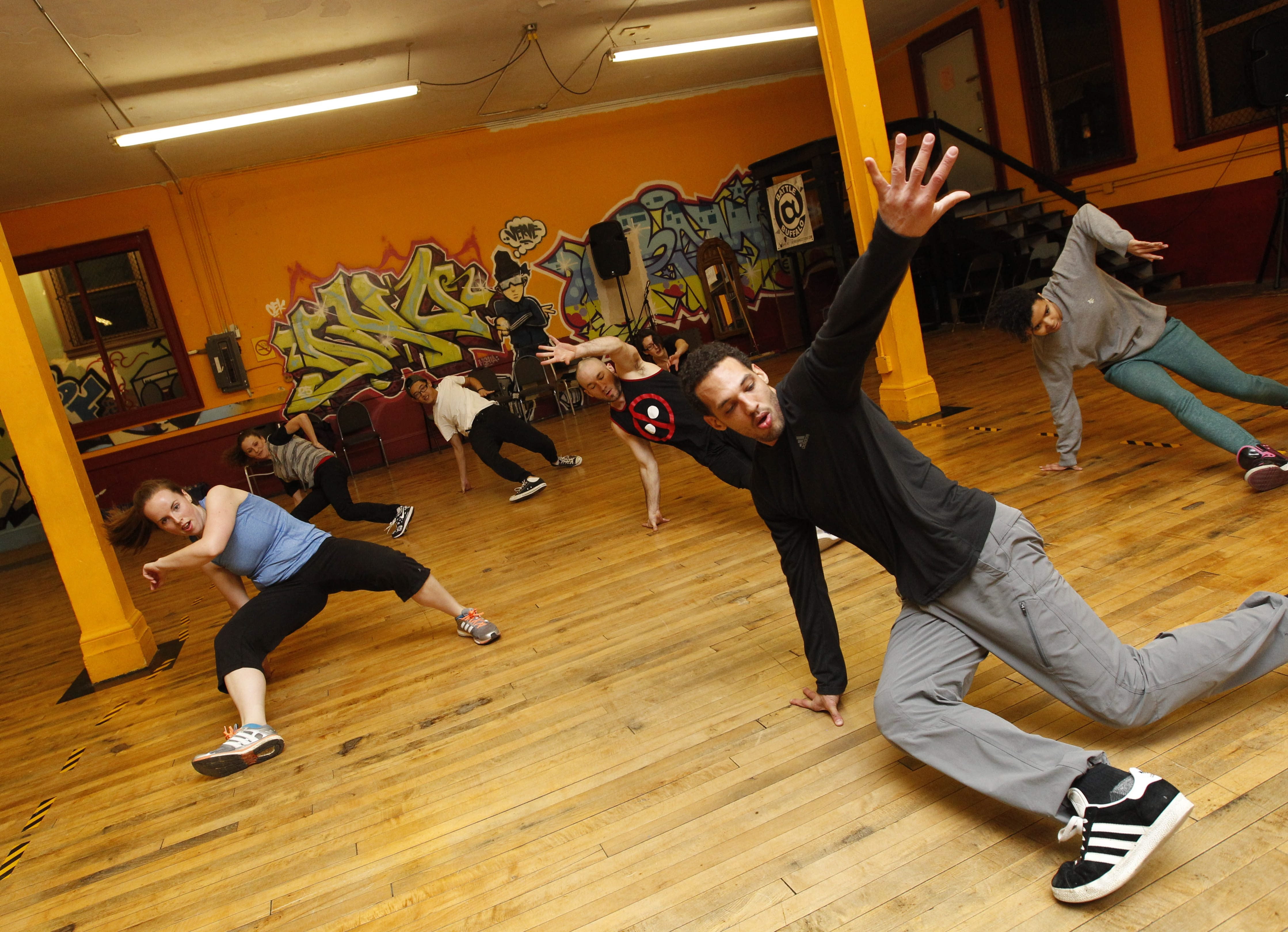 Shane Fry, right, owner and instructor of Verve Dance Studio, 910 Main St., Buffalo, leads the Rock Your Body class.