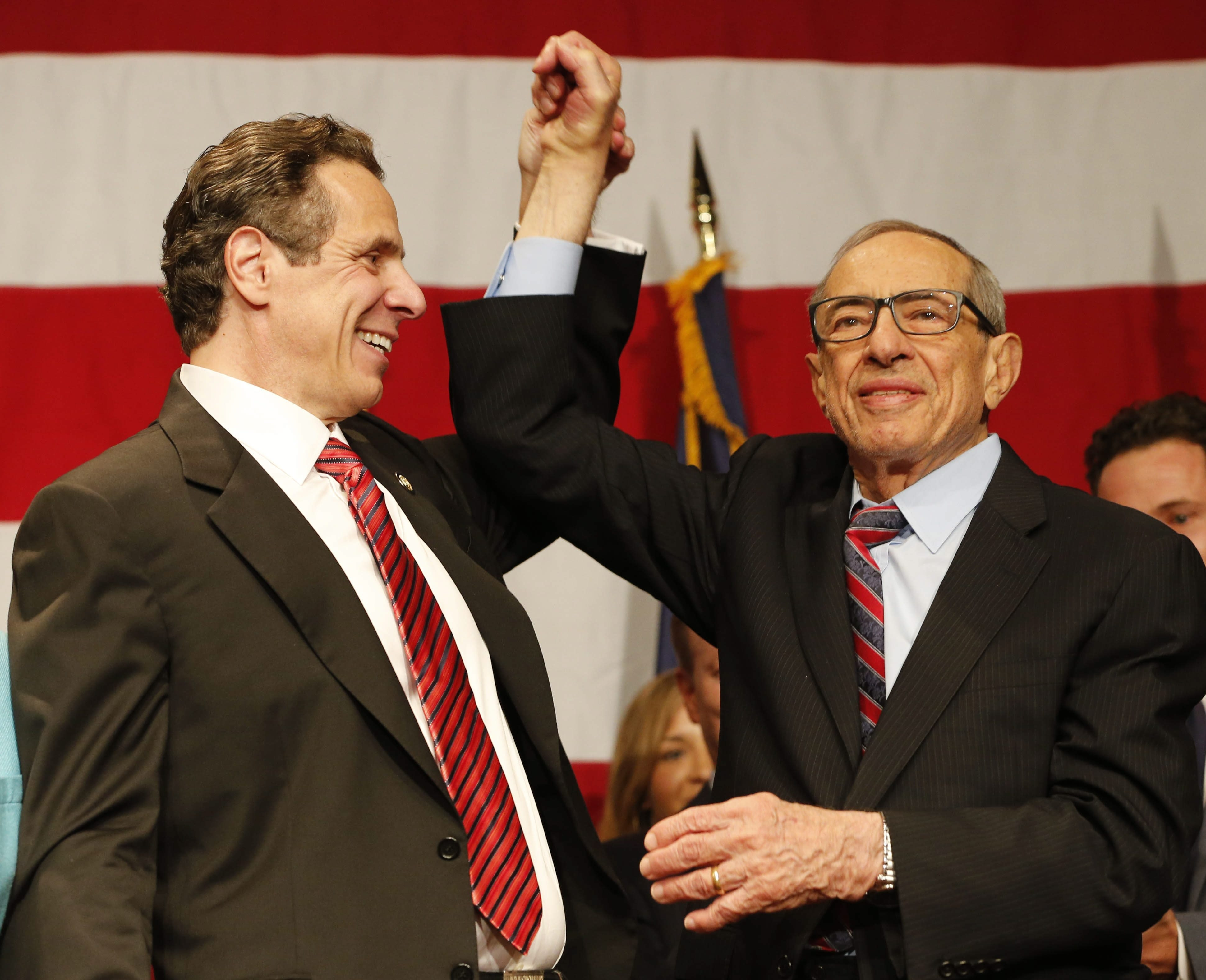 Gov. Andrew Cuomo and his father, former Gov. Mario Cuomo, celebrate Andrew's re-election at the Sheraton New York Times Square in New York City, Tuesday, Nov. 4, 2014.