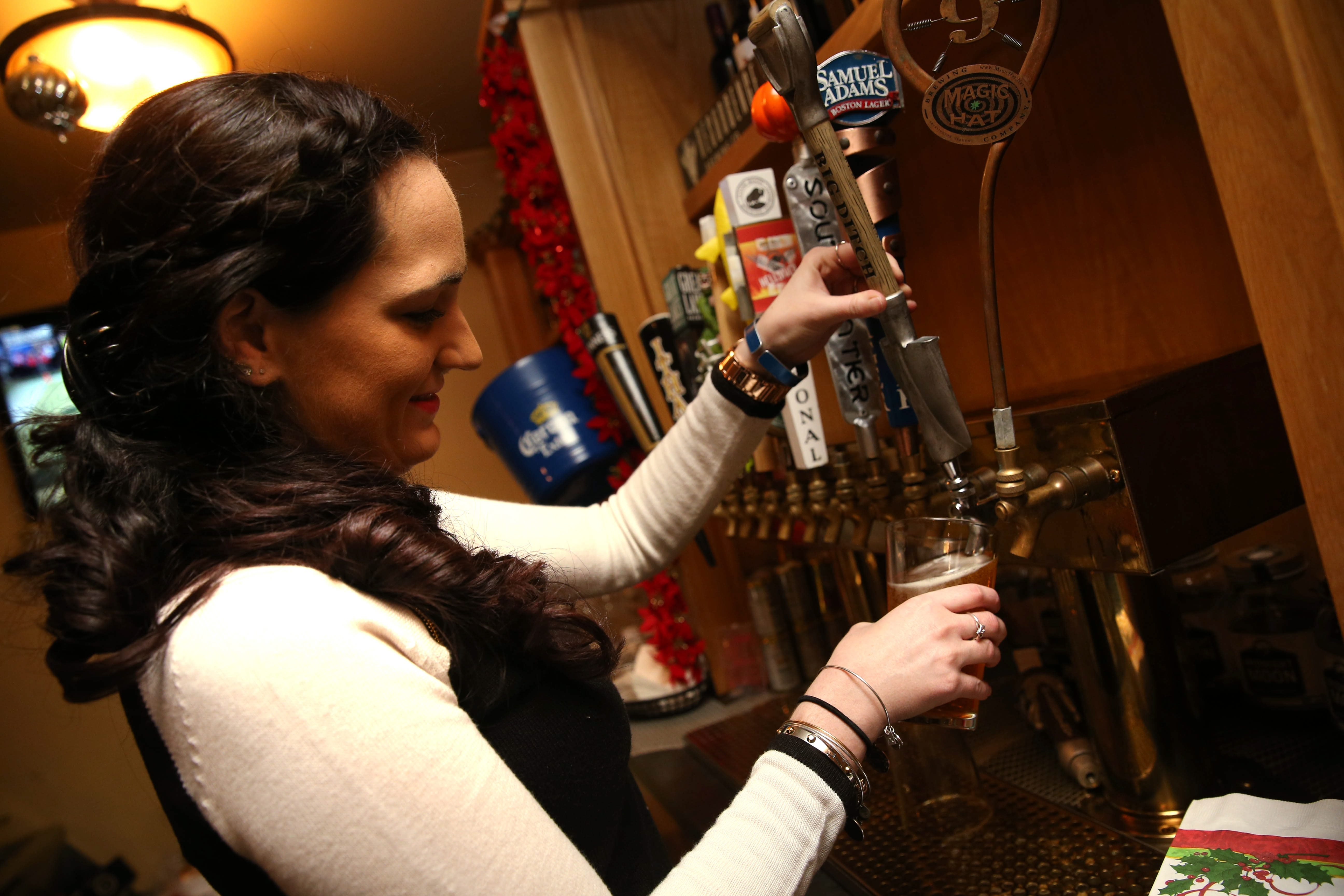 Armor Inn Tap Room is at 5381 Abbott Road in Hamburg. Bartender Allison Keane pours a Bif Ditch Hayburner which is brewed in Buffalo.  Photo taken, Saturday, Dec. 12, 2015.  (Sharon Cantillon/Buffalo News)