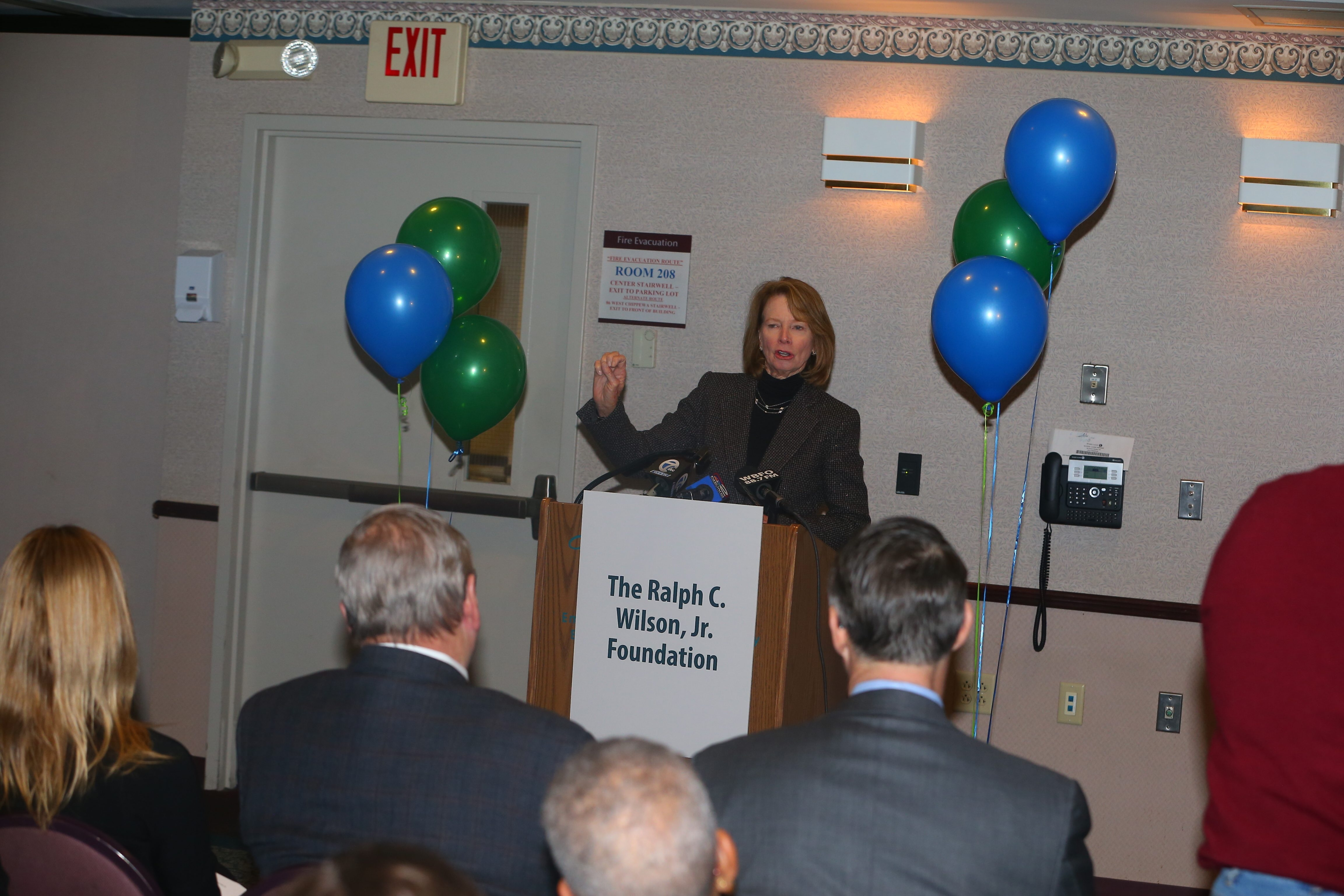 Mary M. Wilson, foundation trustee and widow of the Bills' founding owner, announces $2 million gift to Say Yes Buffalo scholarship fund.