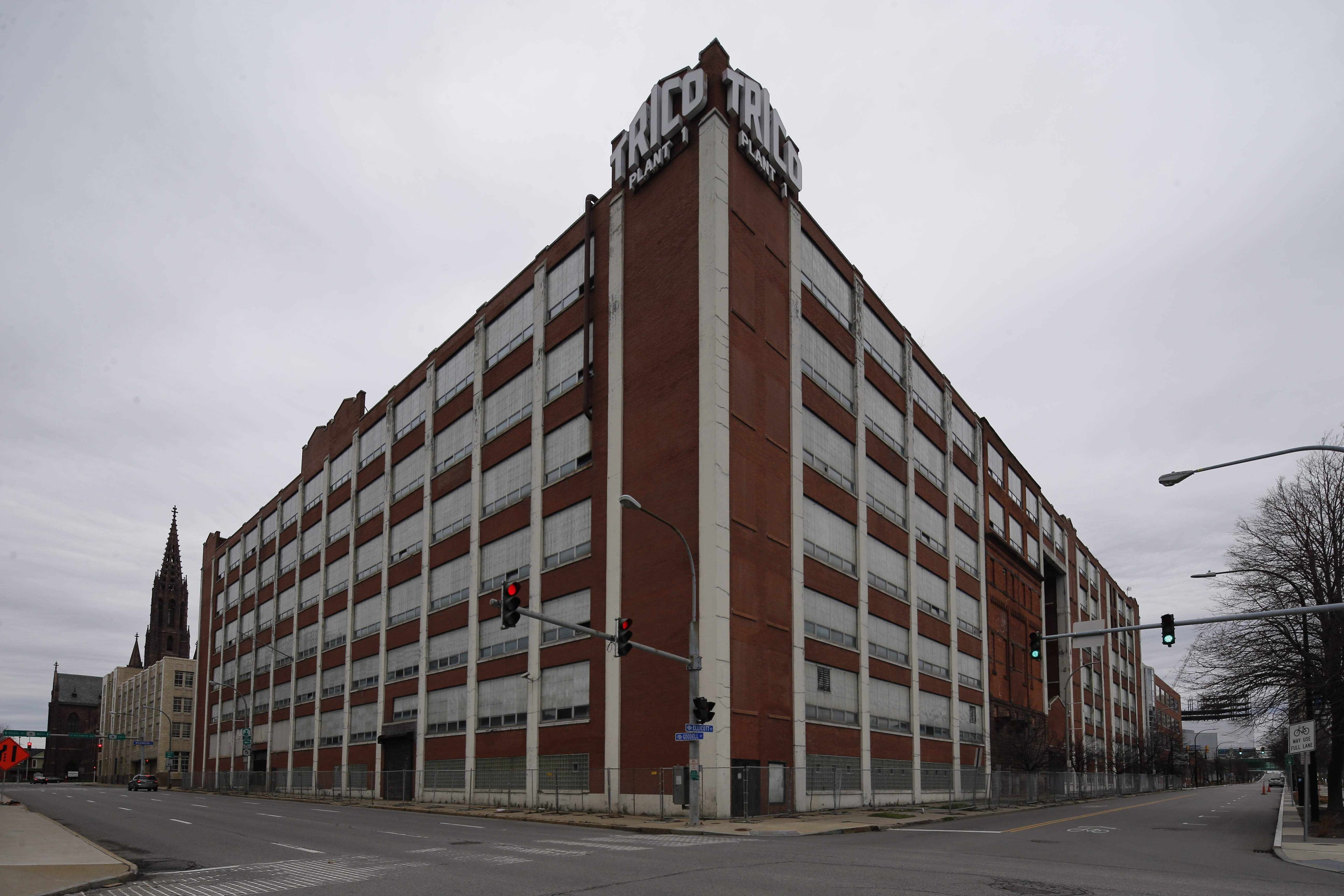 Krog Corp.'s proposal to convert the former Trico building on the corner of Ellicott and Goodell streets into a hotel and apartments is being held up by parking issues related to the project.