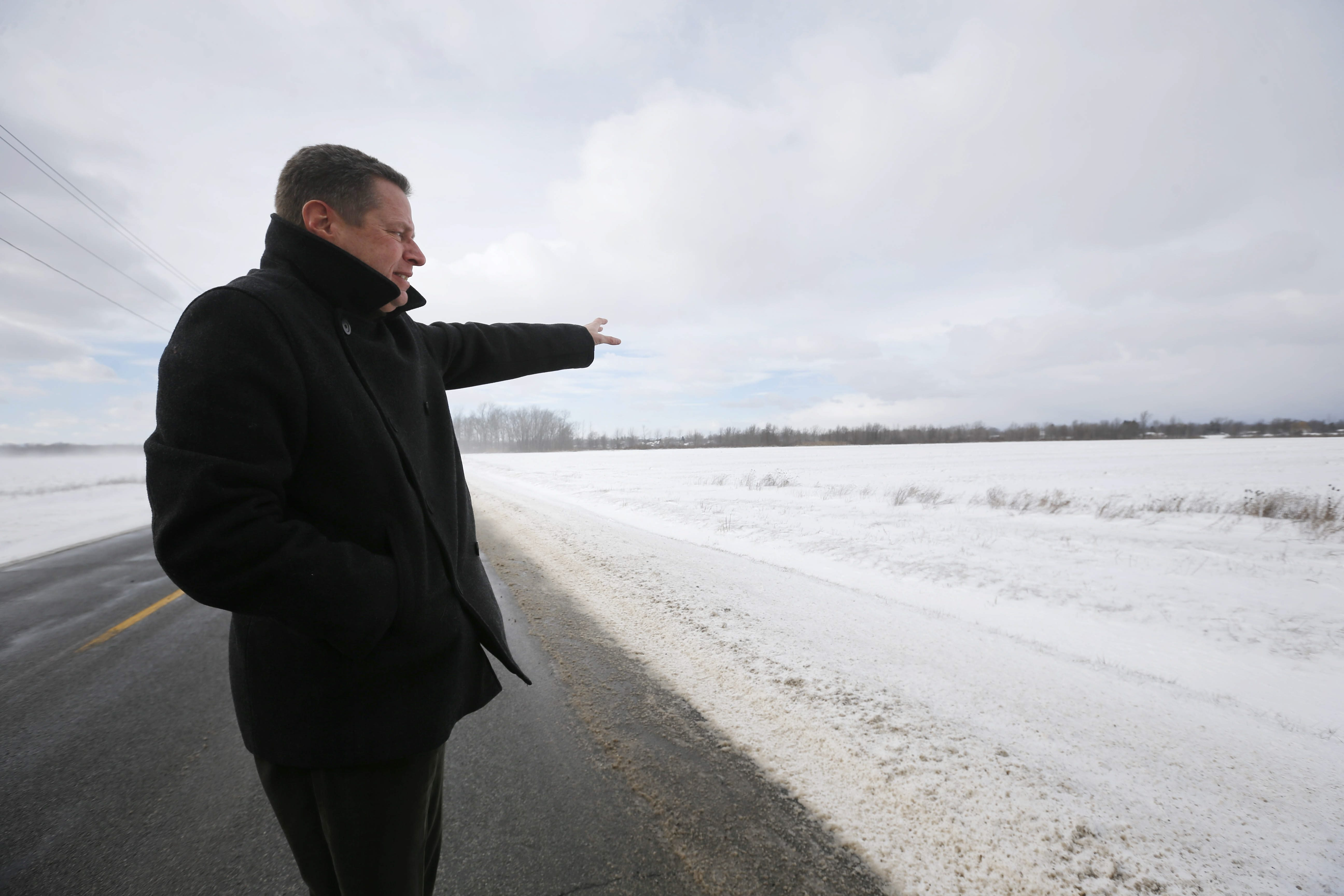 Ronald C. Kraemer, president of Empire Pipeline, points to the field on Killian Road in Pendleton where the company wants to build a compressor station, part of the project to send fracked natural gas from Pennsylvania into Canada.