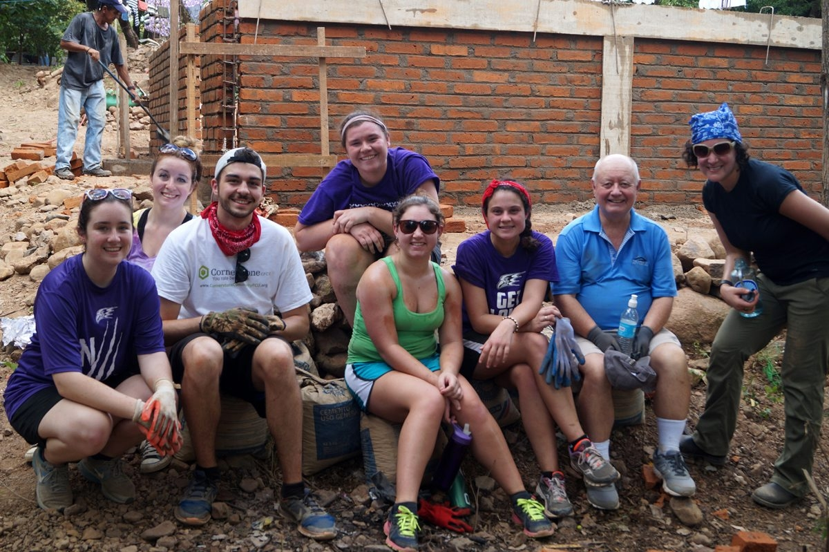 Niagara University students, from left, Rachel Bailey, Amy Wnuk, Jake Eberth, Kelly Fitzpatrick, Briana Neale and Selena Cerra and university chaplain the Rev. Vincent O'Malley and Dr. Abigail L. Levin, associate professor of philosophy, during winter break in Nicaragua, where they spent a week building a home for a poor family.