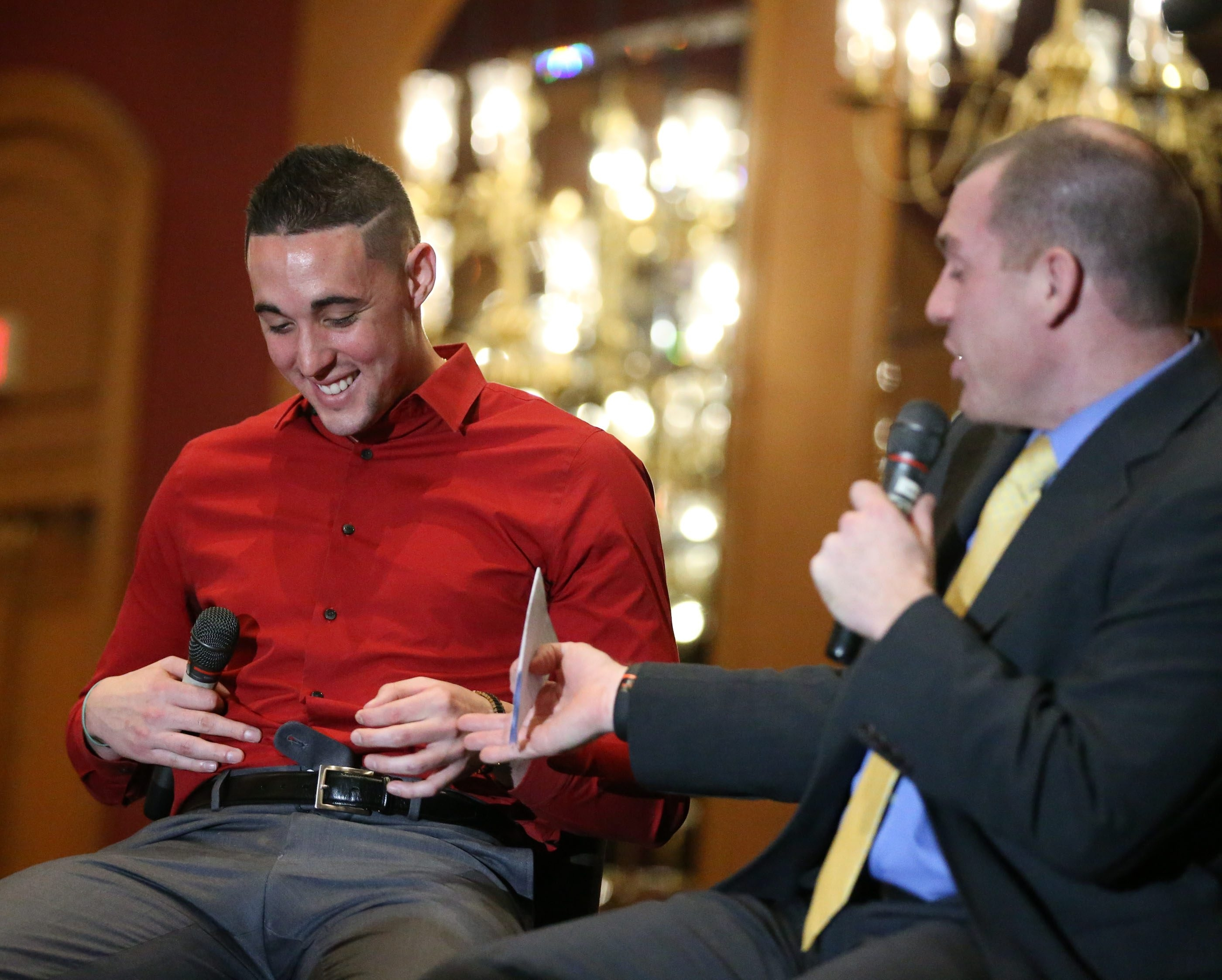 Toronto Blue Jay pitchers Aaron Sanchez shows Ben Wagner, the Voice of the Buffalo Bisons, his pants button that popped Wednesday as a result of his offseason workout program. (James P. McCoy/ Buffalo News)