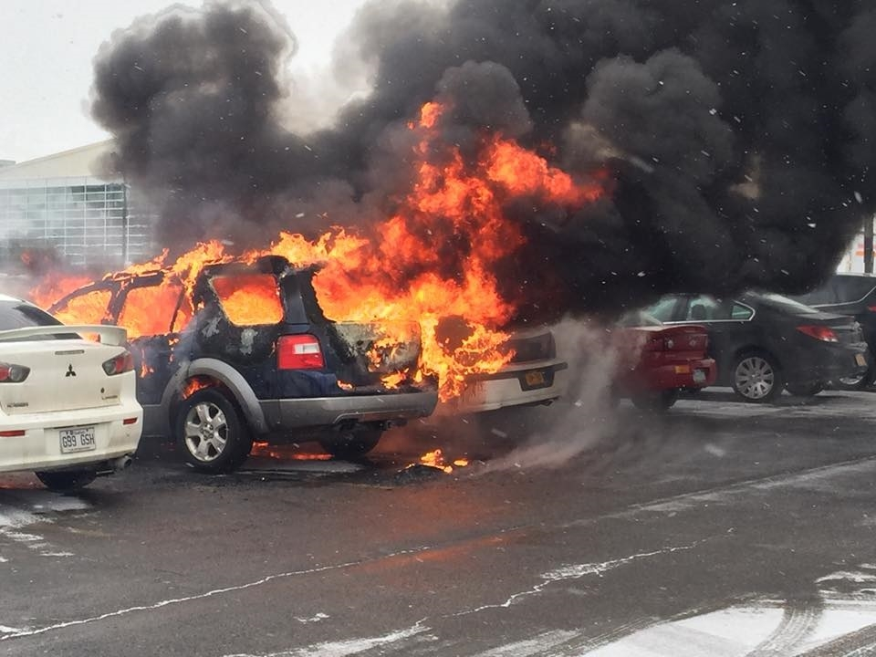 Six vehicles were damaged when a car caught fire Thursday morning outside Dwyer Arena at Niagara University. (Lewiston police)