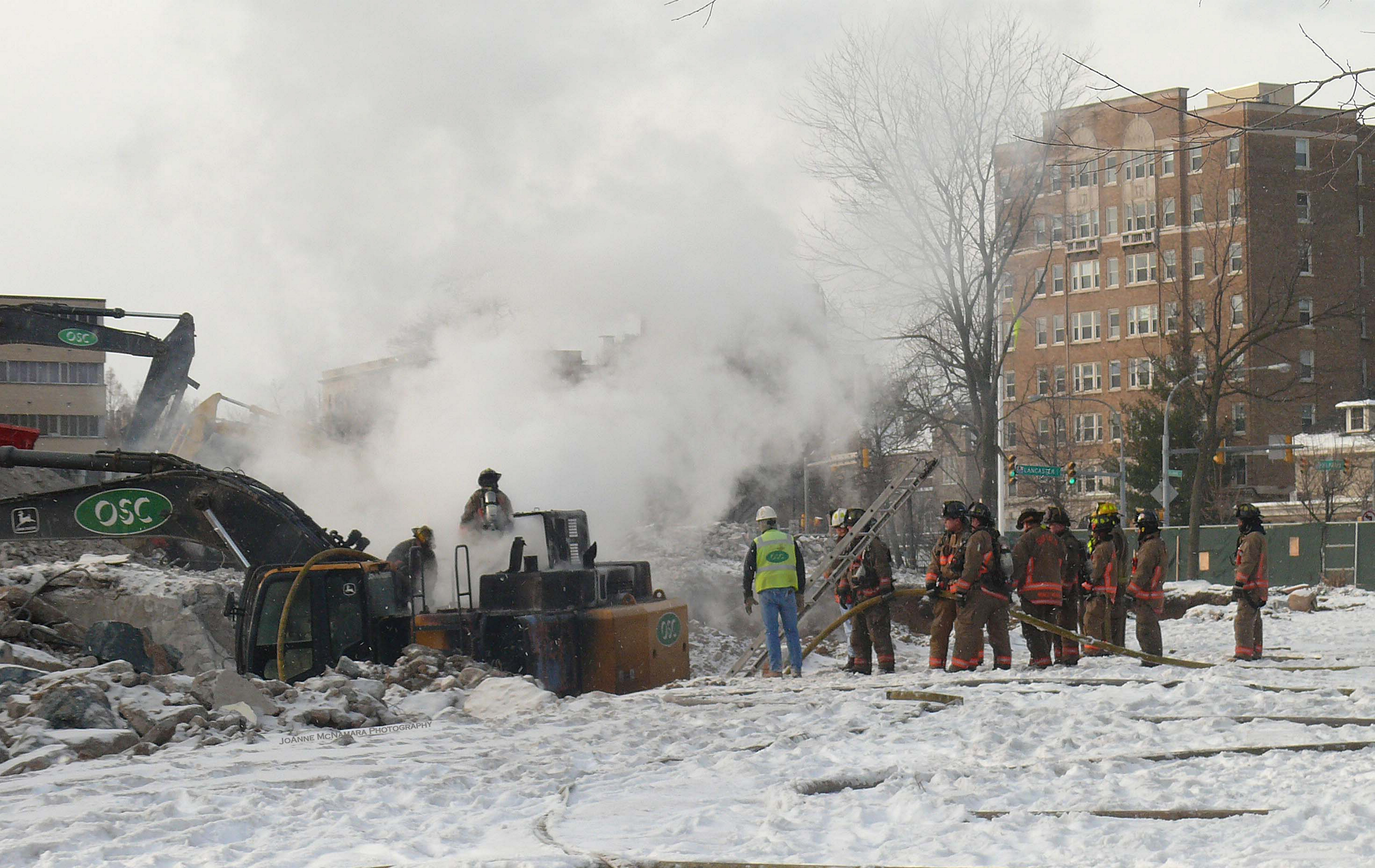 A fire in an excavator at the former Millard Fillmore Hospital site on Gates Circle was extinguished by Buffalo firefighters Saturday morning. (JoAnne McNamara/Special to the News)