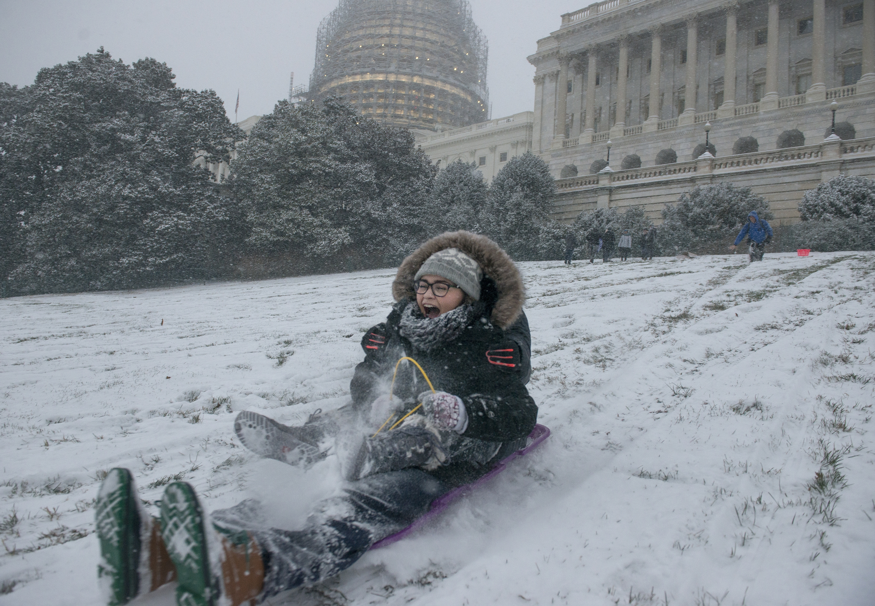 Sled riders hit the hill Friday at the U.S. Capitol in Washington, D.C. Winter storm Jonas was expected to bring up to 2 feet of snow in some areas.  The federal government shut down at noon Friday in anticipation of the event.