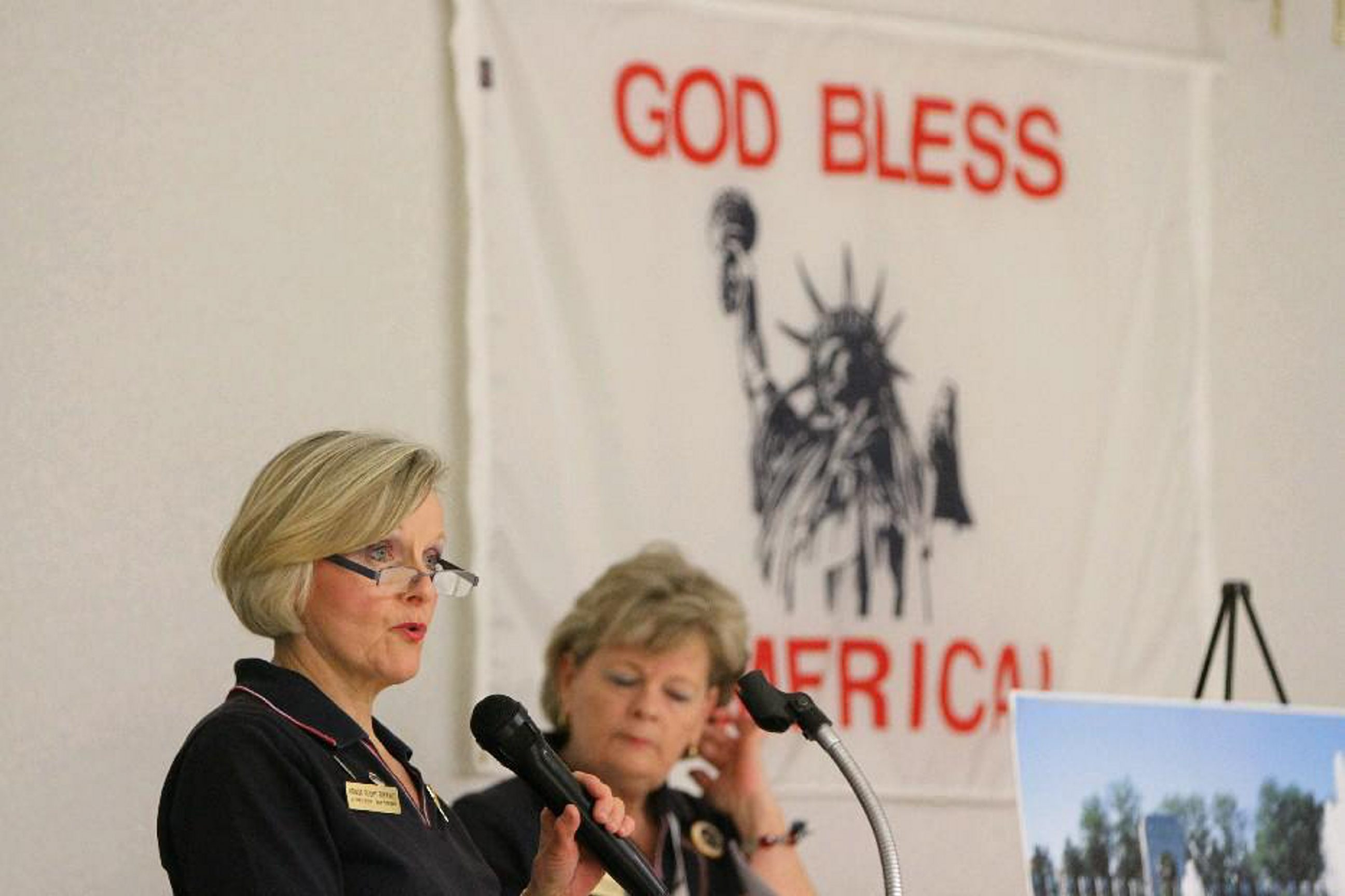 Jo-Anne Wylie, left, and her sister Lisa Wylie speak at an Honor Flight Buffalo meeting with veterans in 2014.The group has dissolved.