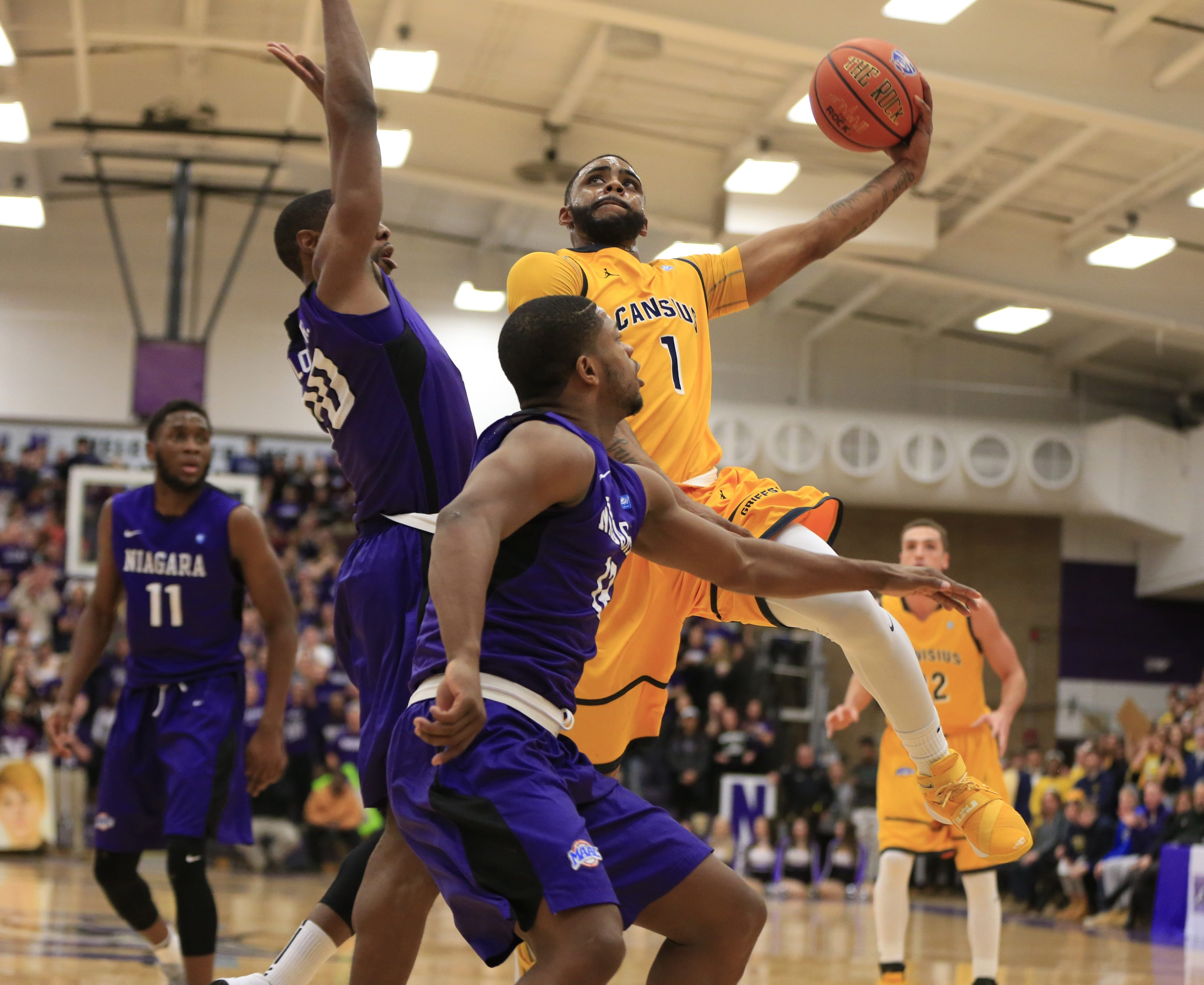 Malcolm McMillan, who led Canisius with 17 points, drives to the basket in the first half against Niagara at the Gallagher Center.