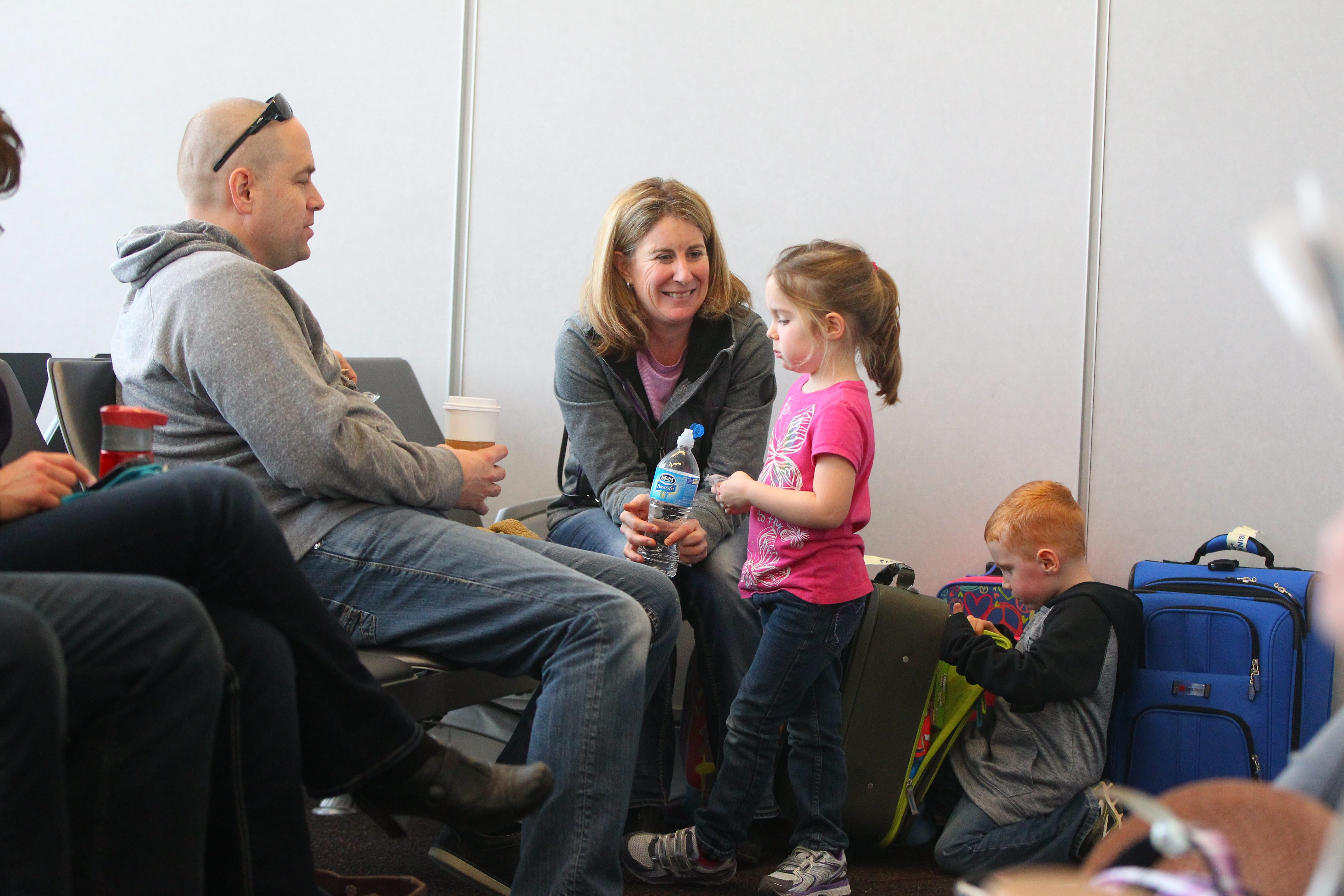 From left, Michael, Nicole, Taylor and Grayson Travale get ready to board a Sunwing flight to Punta Cana on Saturday.