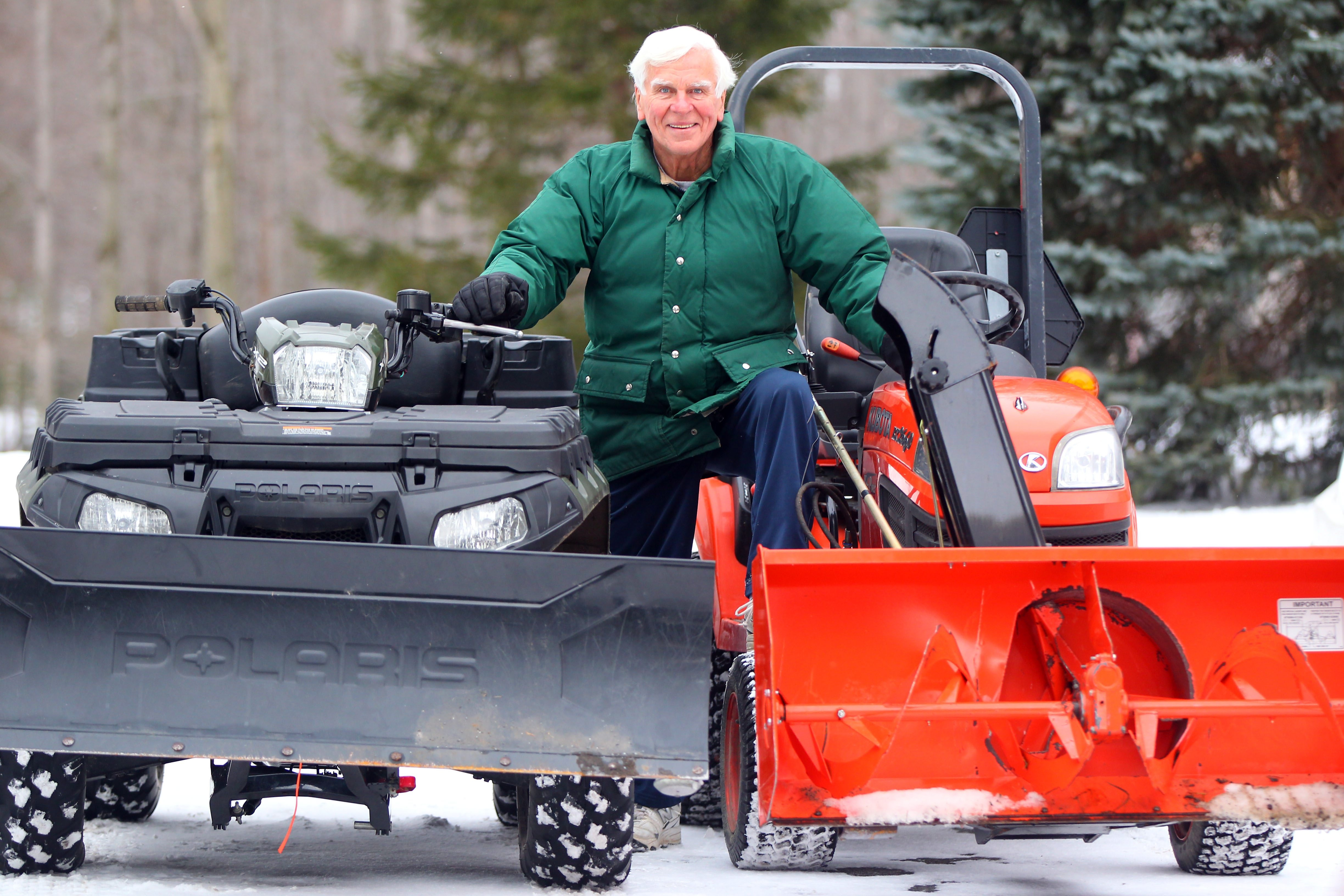 "Retired broadcaster Dan Neaverth shows off his snowfighting equipment Wednesday at his home in Orchard Park. ""I really enjoy the weather,"" he says. ""In fact, it did a lot for my career."""