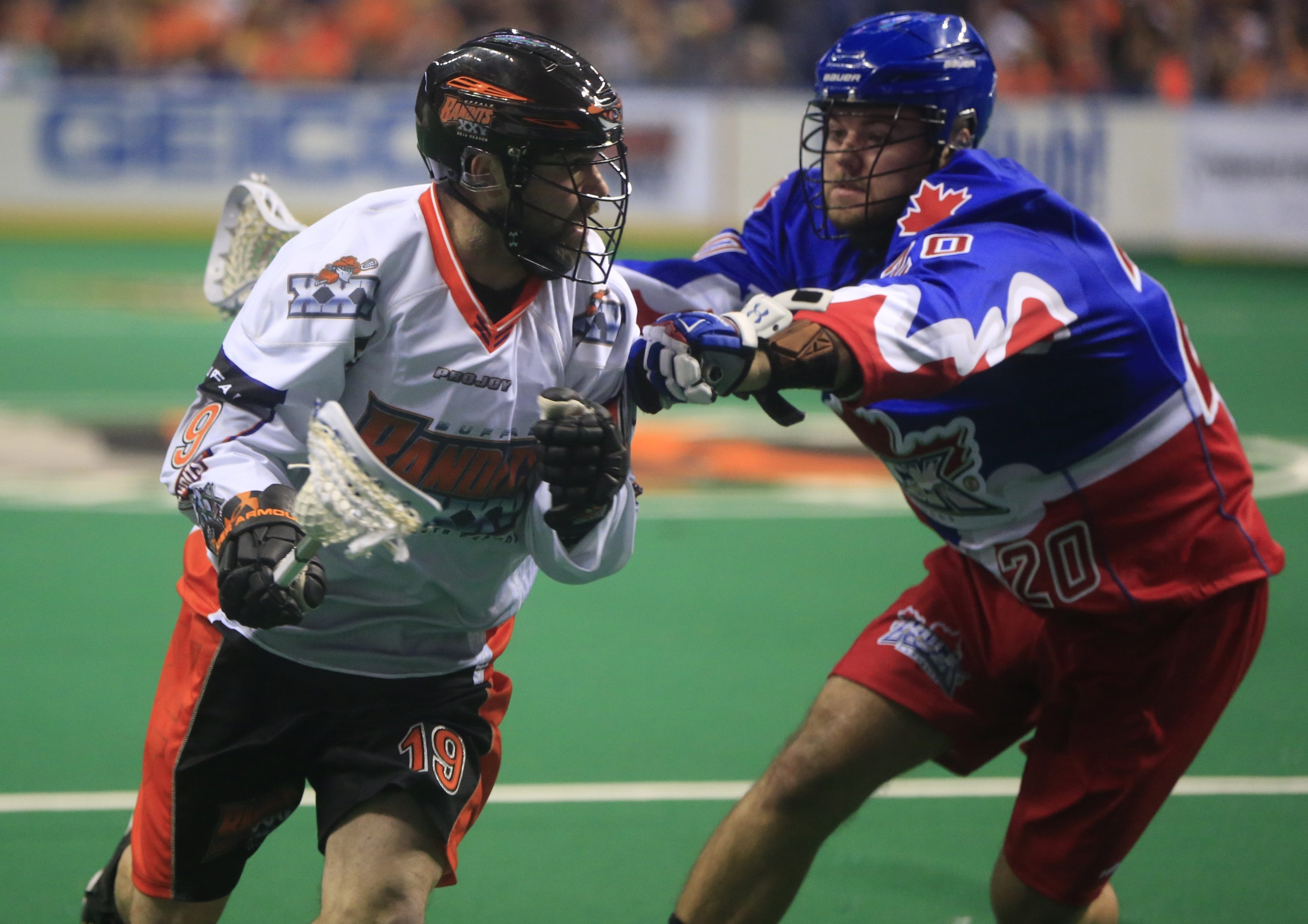 Chad Culp of the Bandits is defended by the Toronto's Bradley Kri during first-quarter action at First Niagara Center on Saturday.