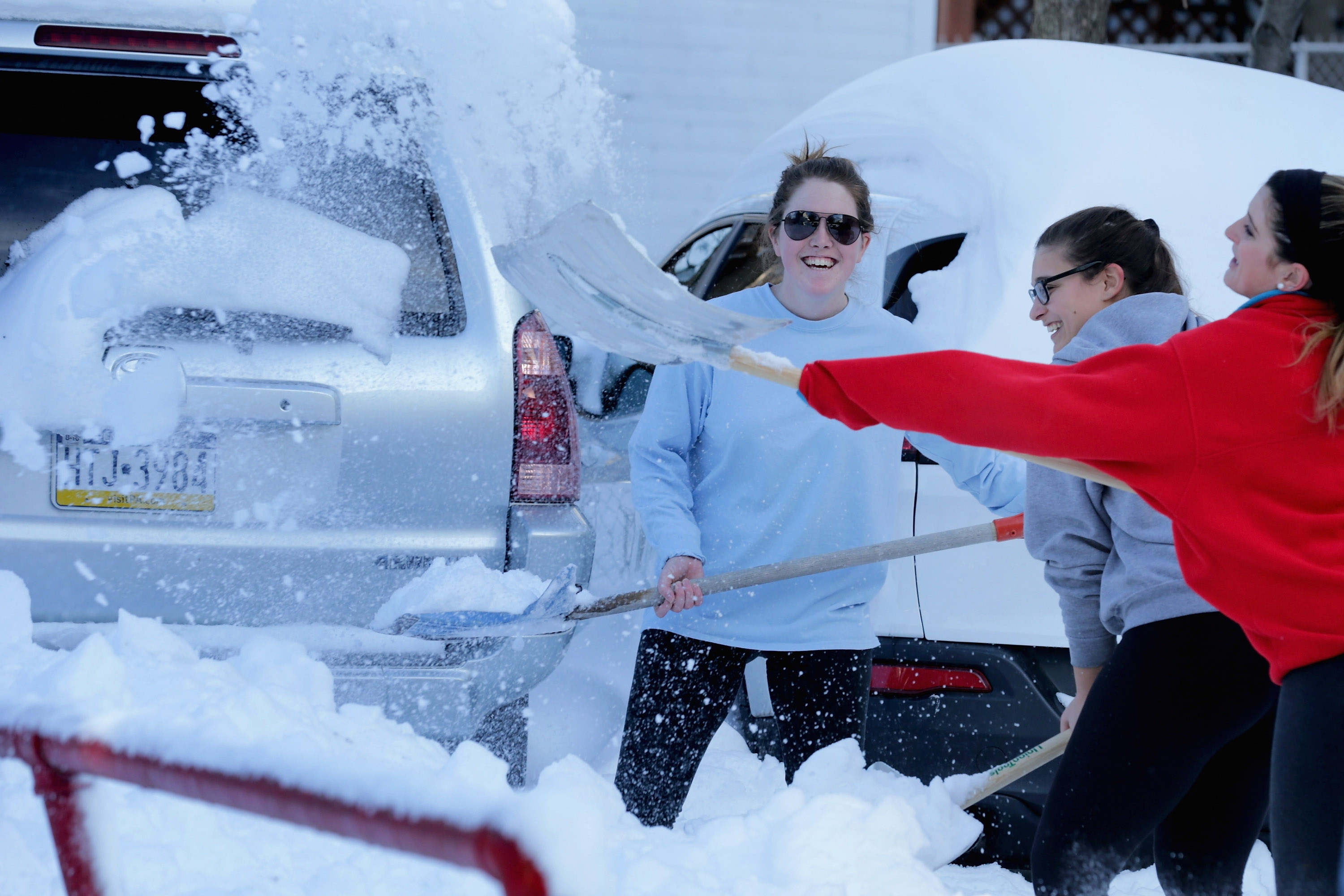 Catholic Unversity students shovel the parking lot behind their house in Washington, D.C., after Winter Storm Jonas covered the region with more than two feet of snow. (Getty Images)