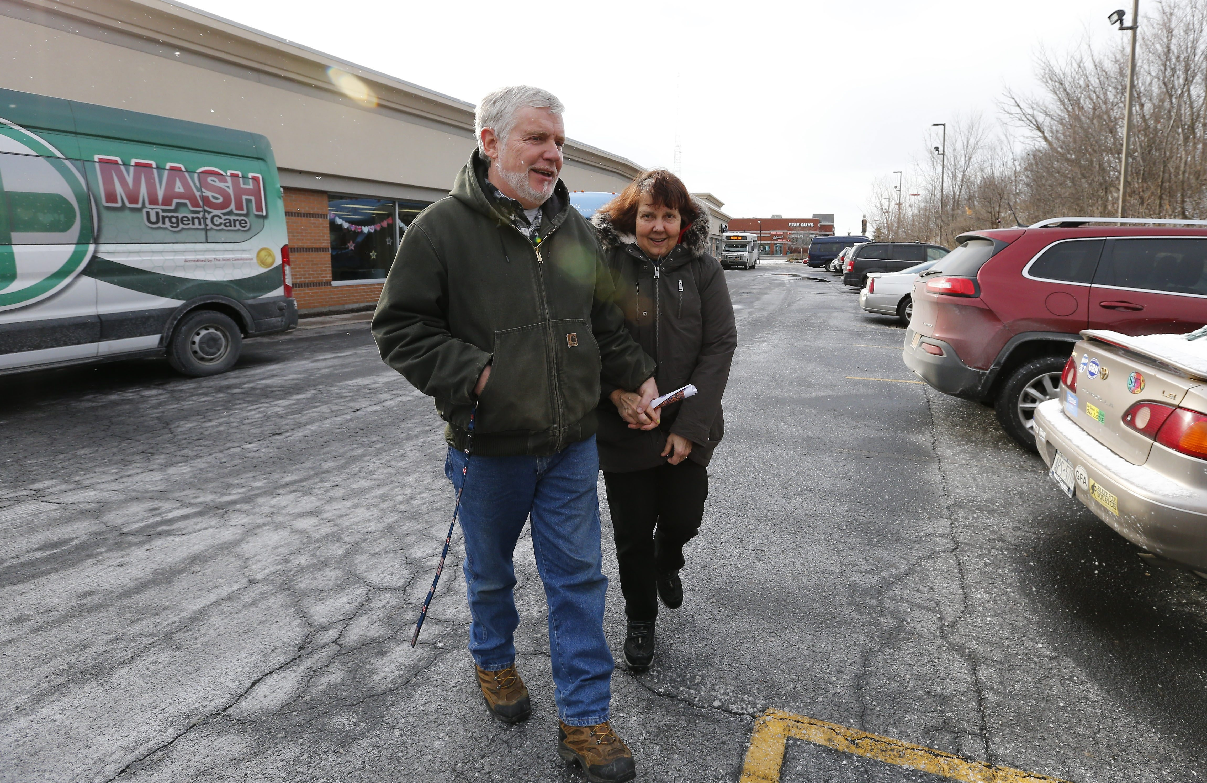 Bob Waddell picks up his wife, Marge, from People Inc.'s adult day care program for people with dementia in North Buffalo on Friday.
