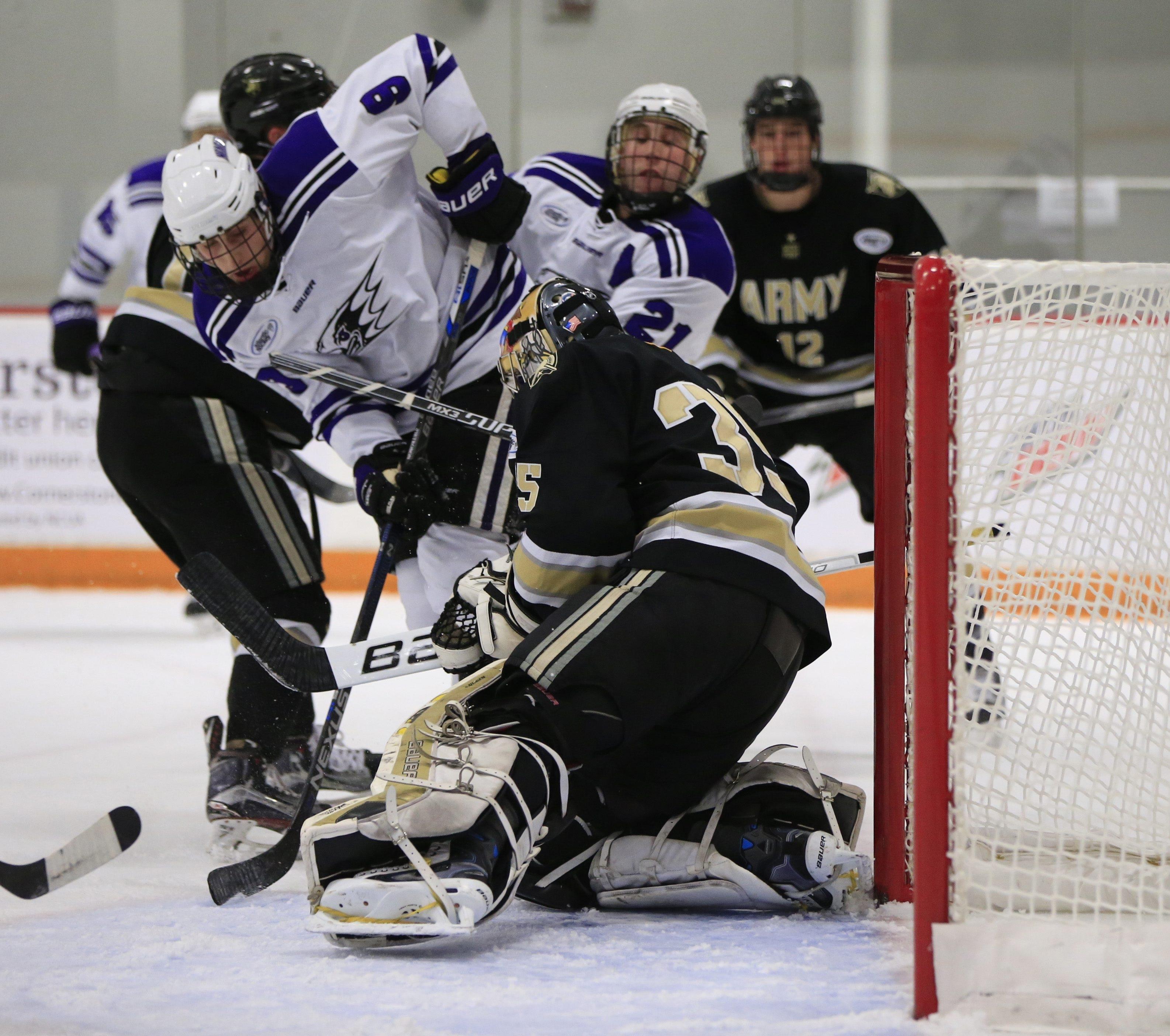 Army goaltender Parker Gahagen stops Niagara University's Stephen Pietrobon during the second period.