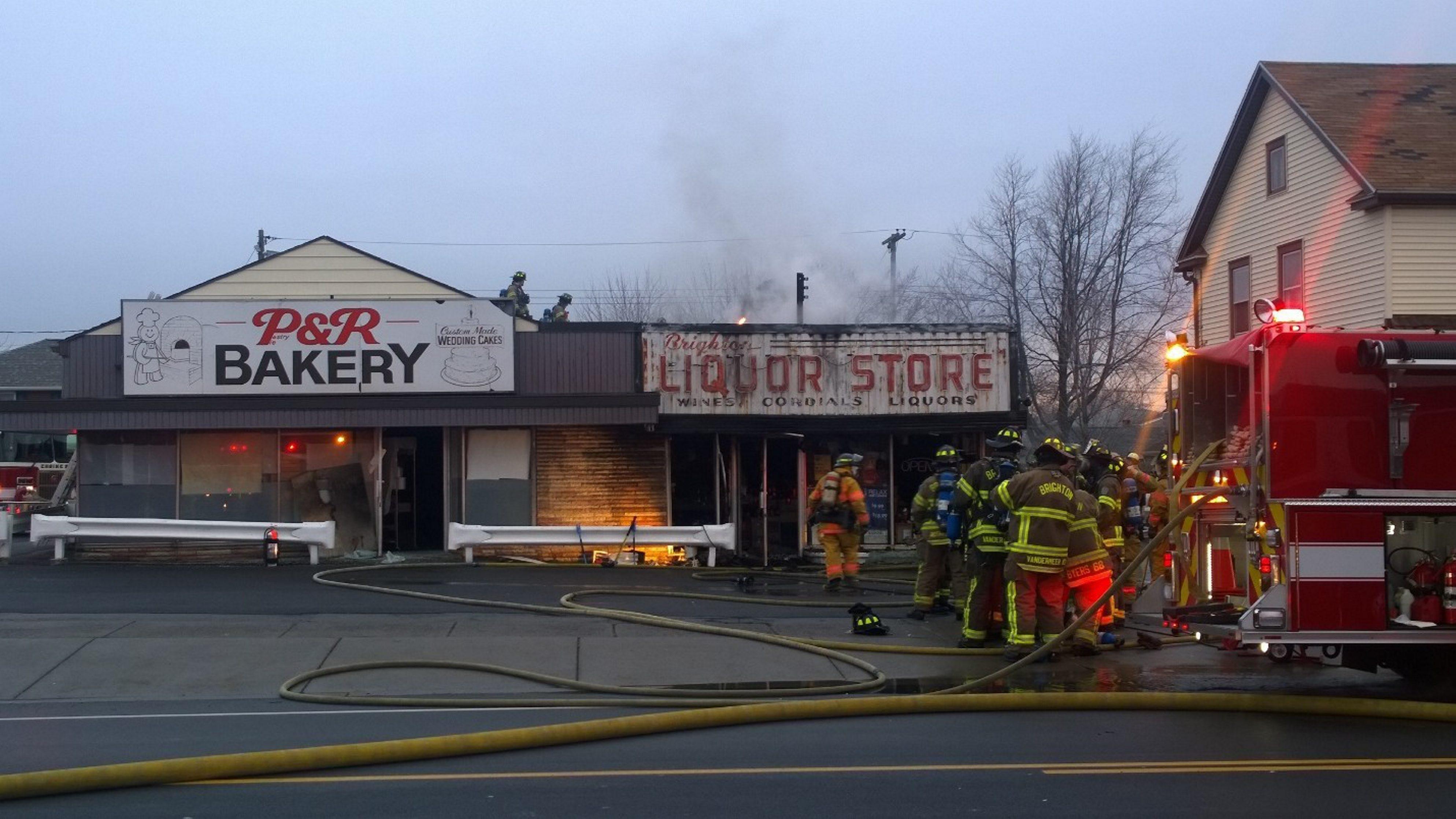 The scene at Sunday morning's fire at Brighton Liquor Store. (David Kazmierczak/Special to The News)