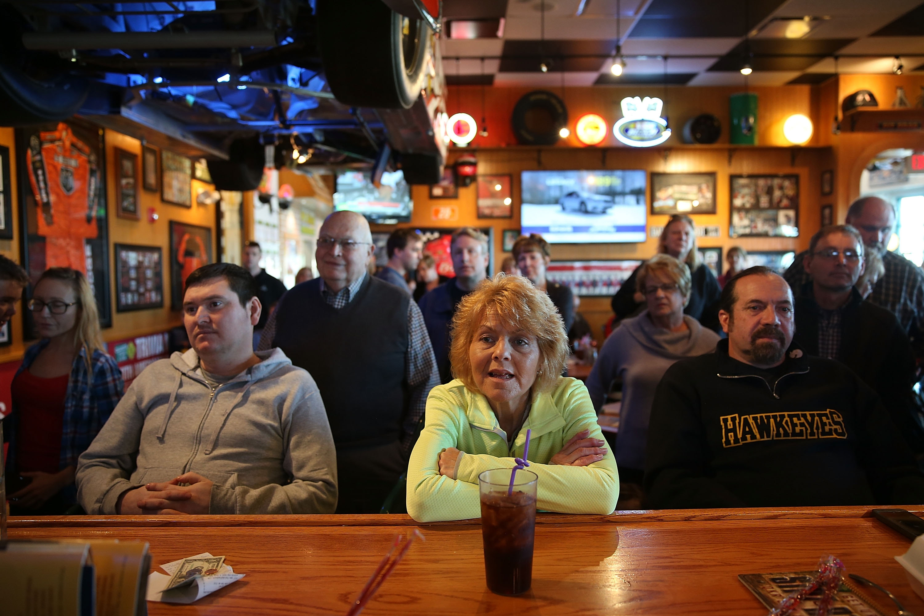 Patrons at a Quaker Steak & Lube restaurant listen to remarks by Republican presidential candidate Chris Christie, the governor of New Jersey, during a campaign event in Council Bluffs, Iowa. The Iowa caucuses will be held Monday night.