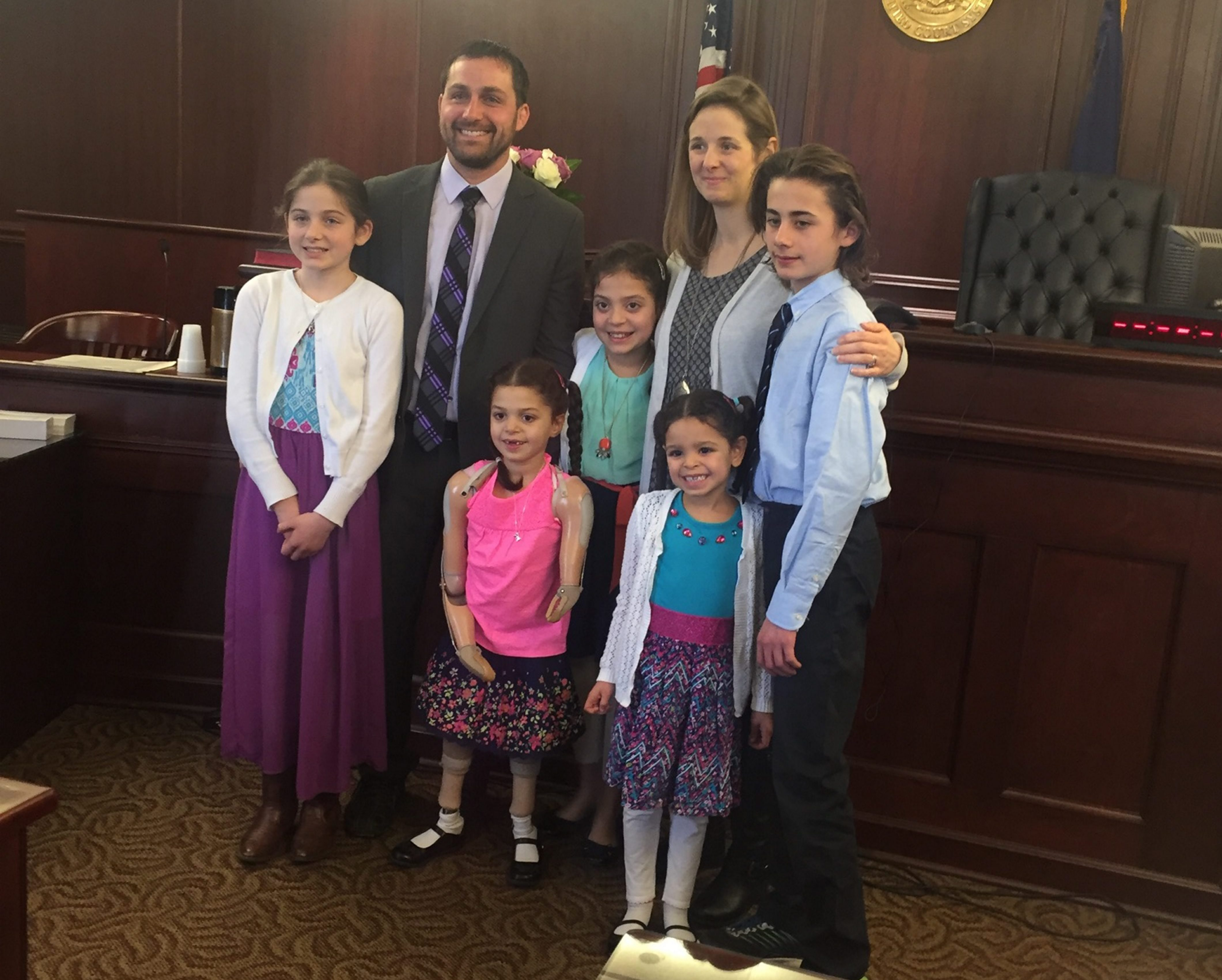 Shortly before Christmas, Vaillancourt family of Town of Tona-wanda – from left, Hailey, Phil, Josie, Kamila, Kim, Chalie and Ryan – rejoices in Family Court. Days later, their lives changed.