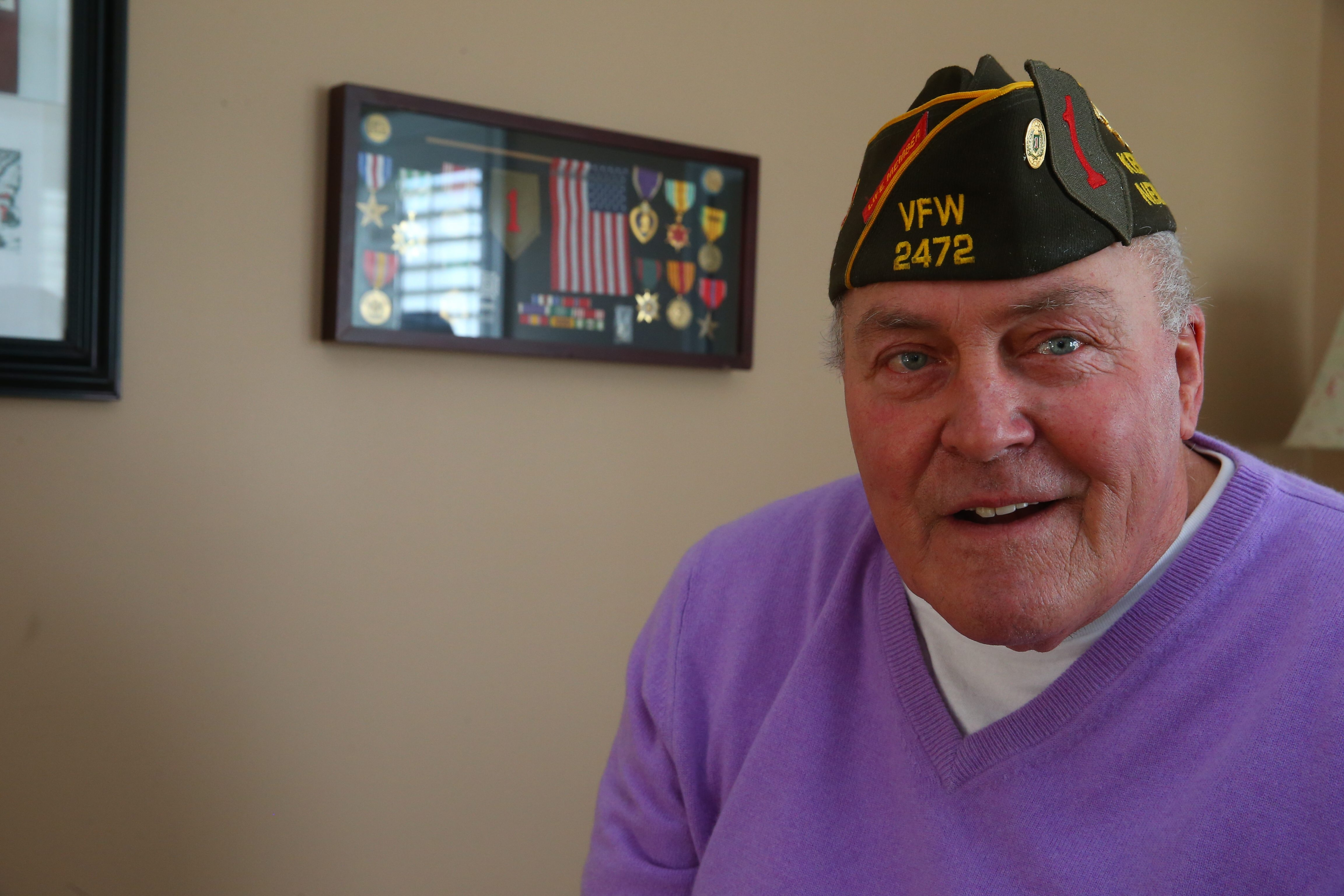 John Washington, wear- ing his VFW service cap, has his medals on display at Wheatfield home from heroic Vietnam service.