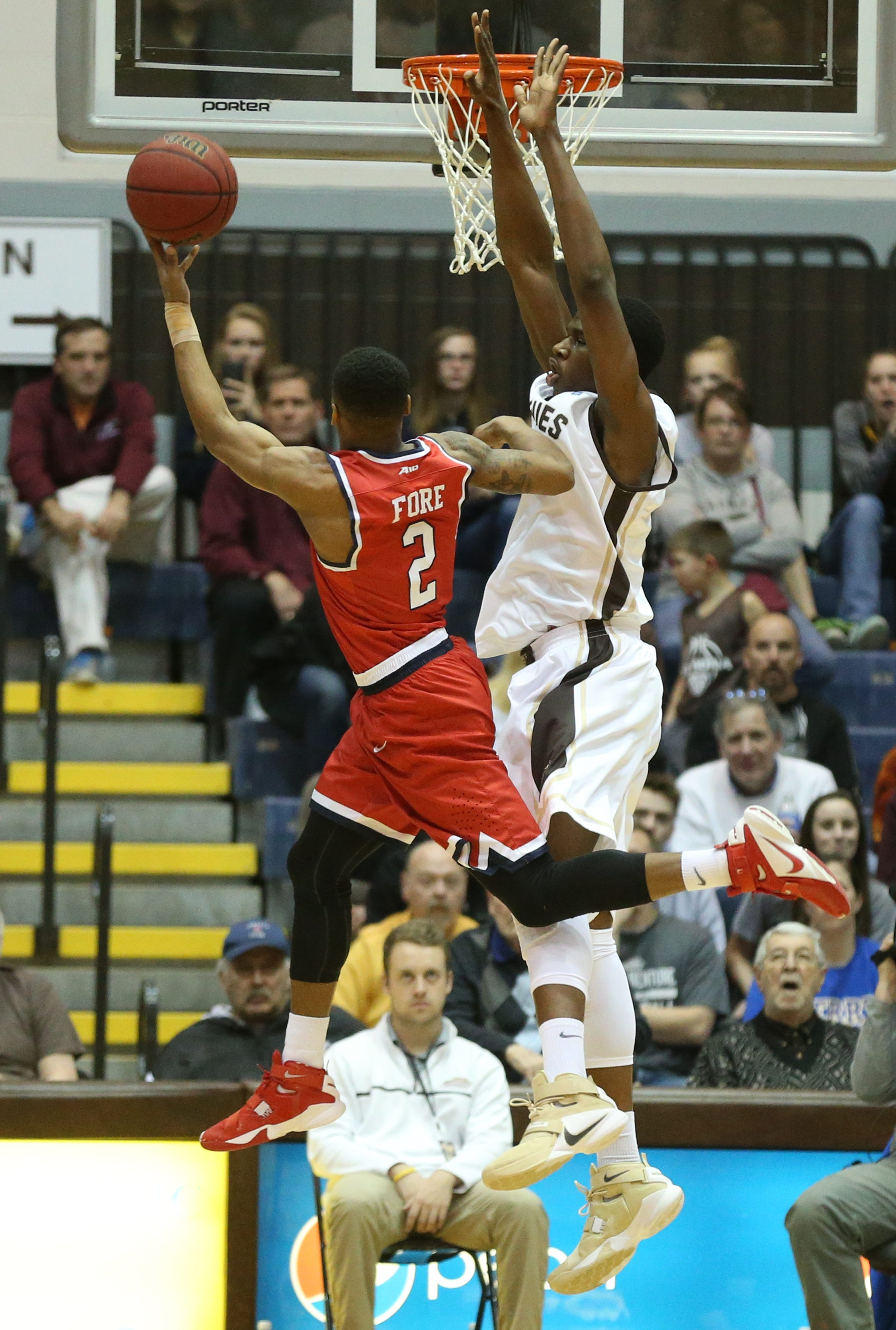 St. Bonaventure's Jordan Tyson blocks a shot by Richmond guard Khwan Fore in the first half. Tyson, a 6-10 redshirt freshman center, had five blocks, five points and five rebounds in 20 minutes.
