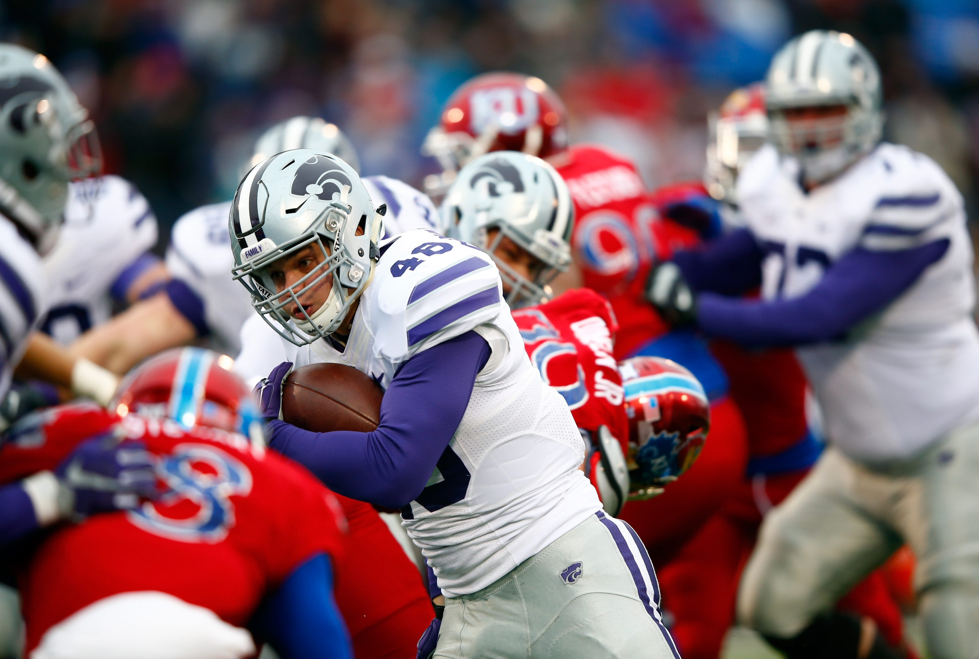 LAWRENCE, KS - NOVEMBER 28:  Fullback Glenn Gronkowski #48 of the Kansas State Wildcats carries the ball into the end zone during the game against the Kansas Jayhawks at Memorial Stadium on November 28, 2015 in Lawrence, Kansas.  (Photo by Jamie Squire/Getty Images)