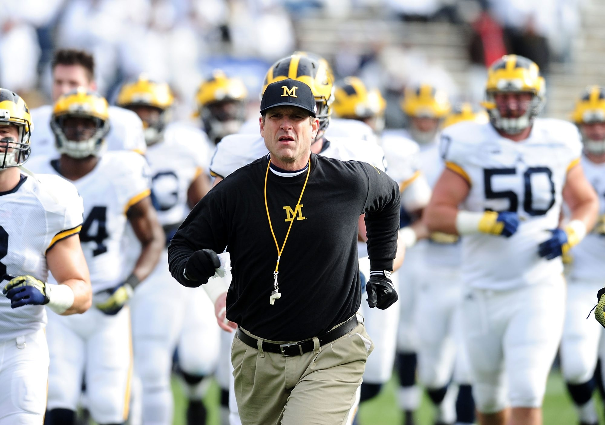 What Jim Harbaugh did wasn't wrong, but it shows the darker side of college recruiting.