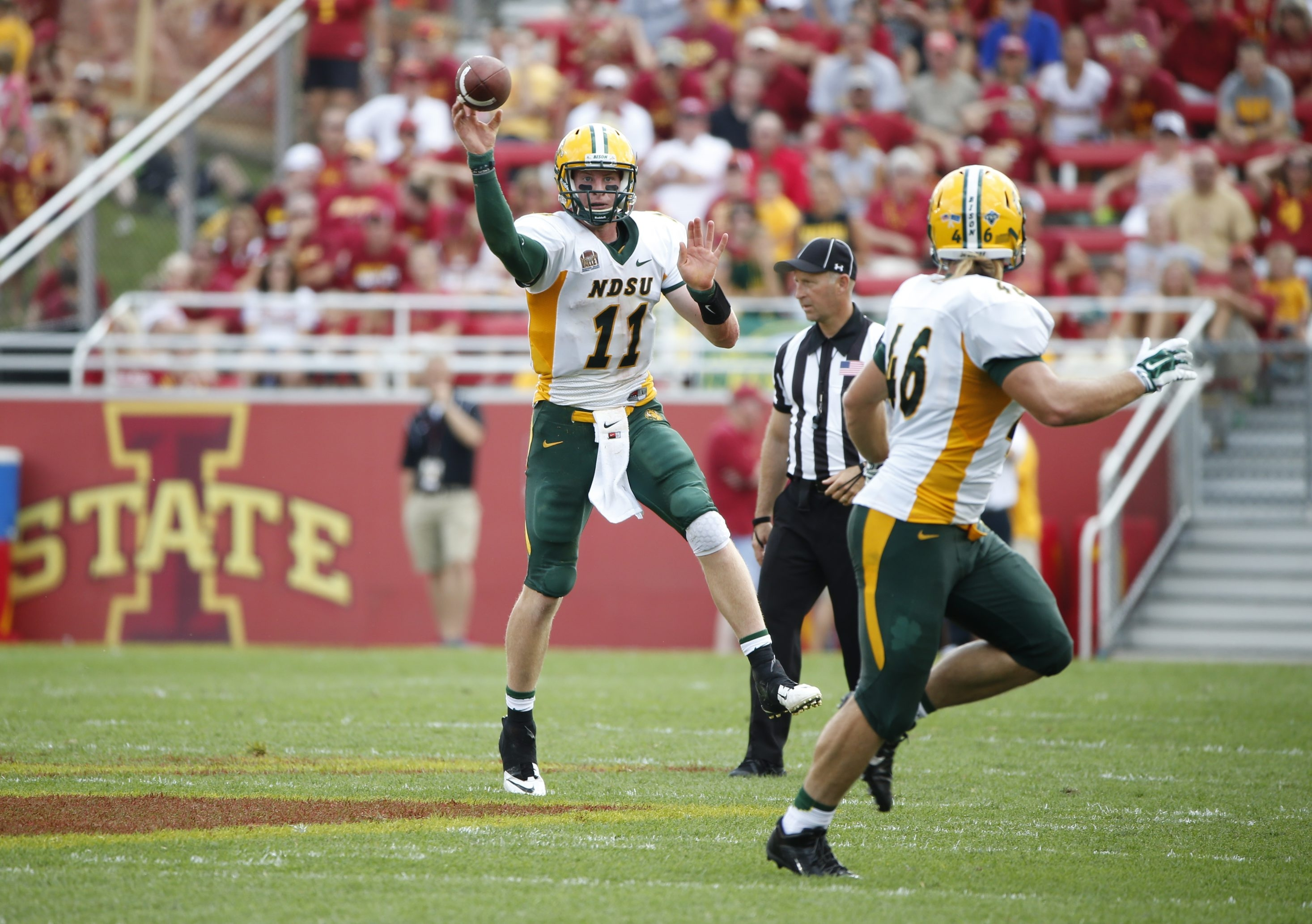 AMES, IA - AUGUST 30: Quarterback Carson Wentz #11 of the North Dakota State Bison passes to teammate fullback Andrew Bonnet #46 of the North Dakota State Bison in the second half of play against the Iowa State Cyclones at Jack Trice Stadium on August 30, 2014 in Ames, Iowa. North Dakota State defeated Iowa State 34-14. (Photo by David Purdy/Getty Images)