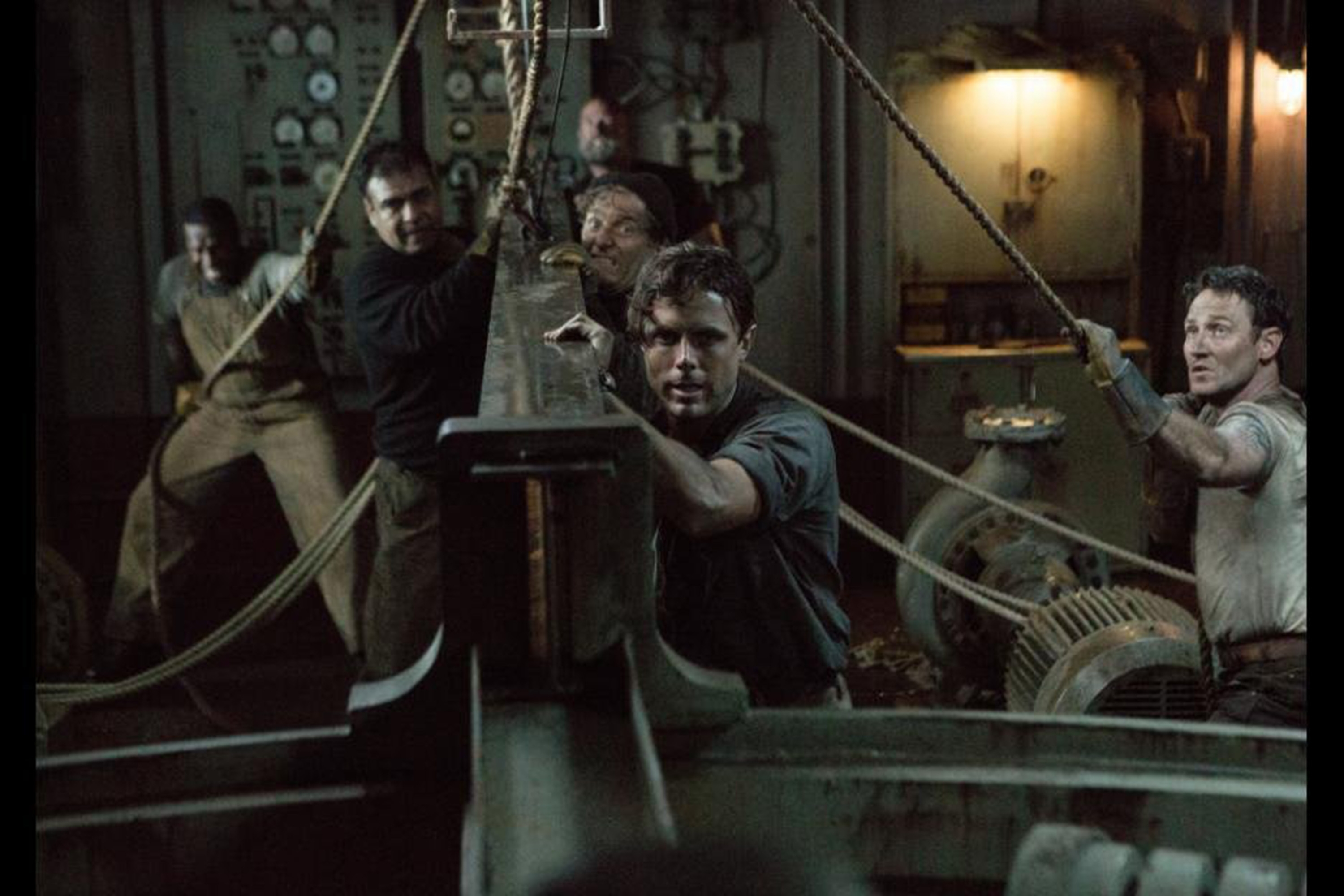 "Casey Affleck, front, stars in ""The Finest Hours."""
