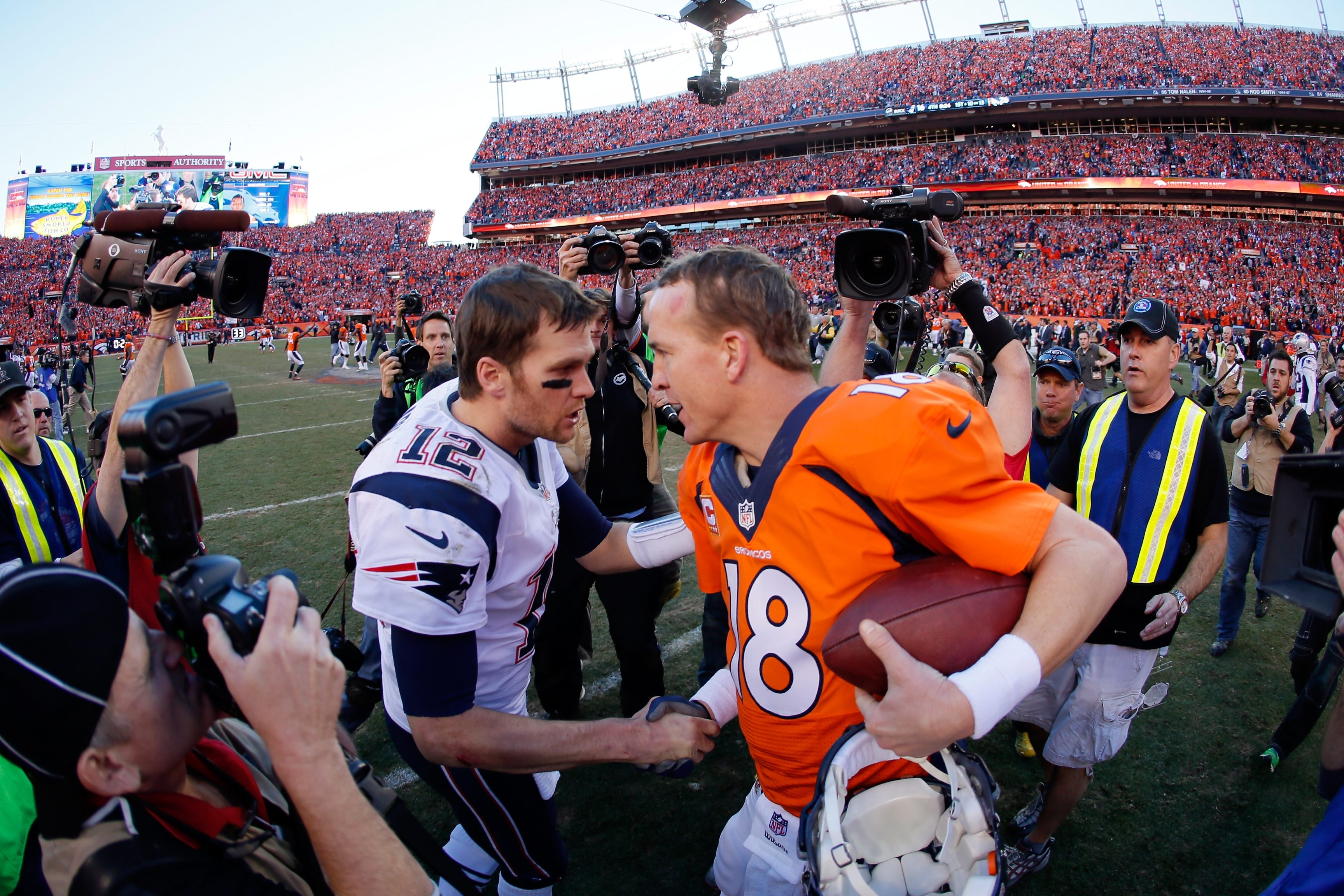 New England QB Tom Brady congratulates Denver QB Peyton Manning after the Broncos defeated the Patriots, 26-16, for the AFC Championship in January, 2014.