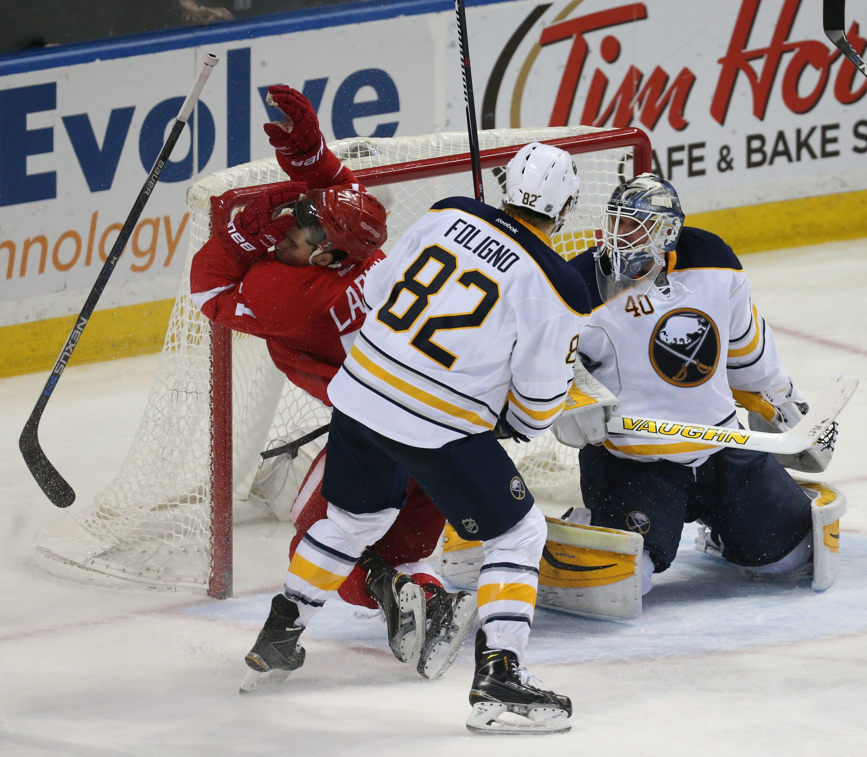 Buffalo Sabres left wing Marcus Foligno received a four-minute penalty for high sticking and slamming Detroit Red Wings center Dylan Larkin into the net.