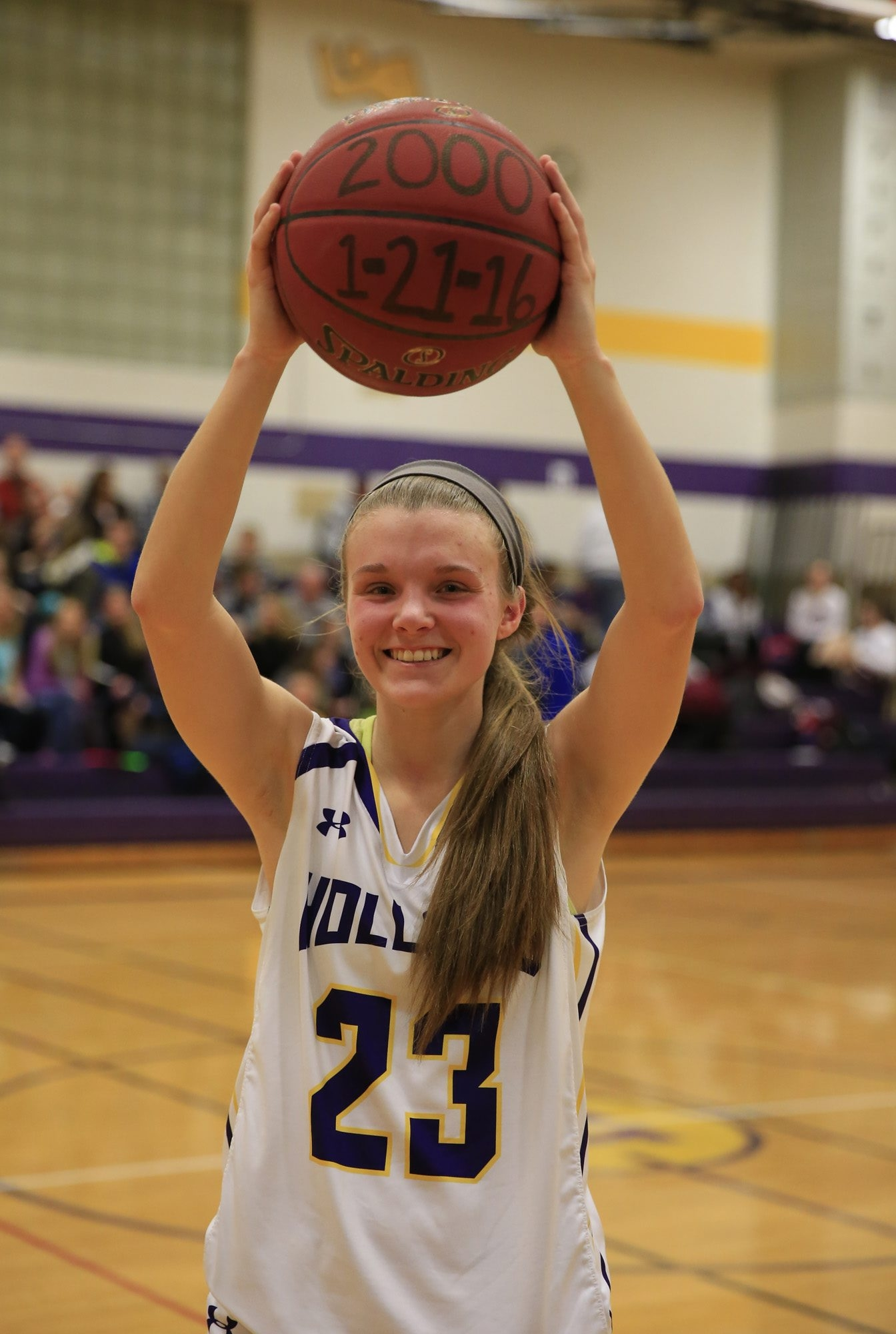 Holland's Olivia Schmidt celebrates after scoring her 2,000th career point during a triumph over Tonawanda.
