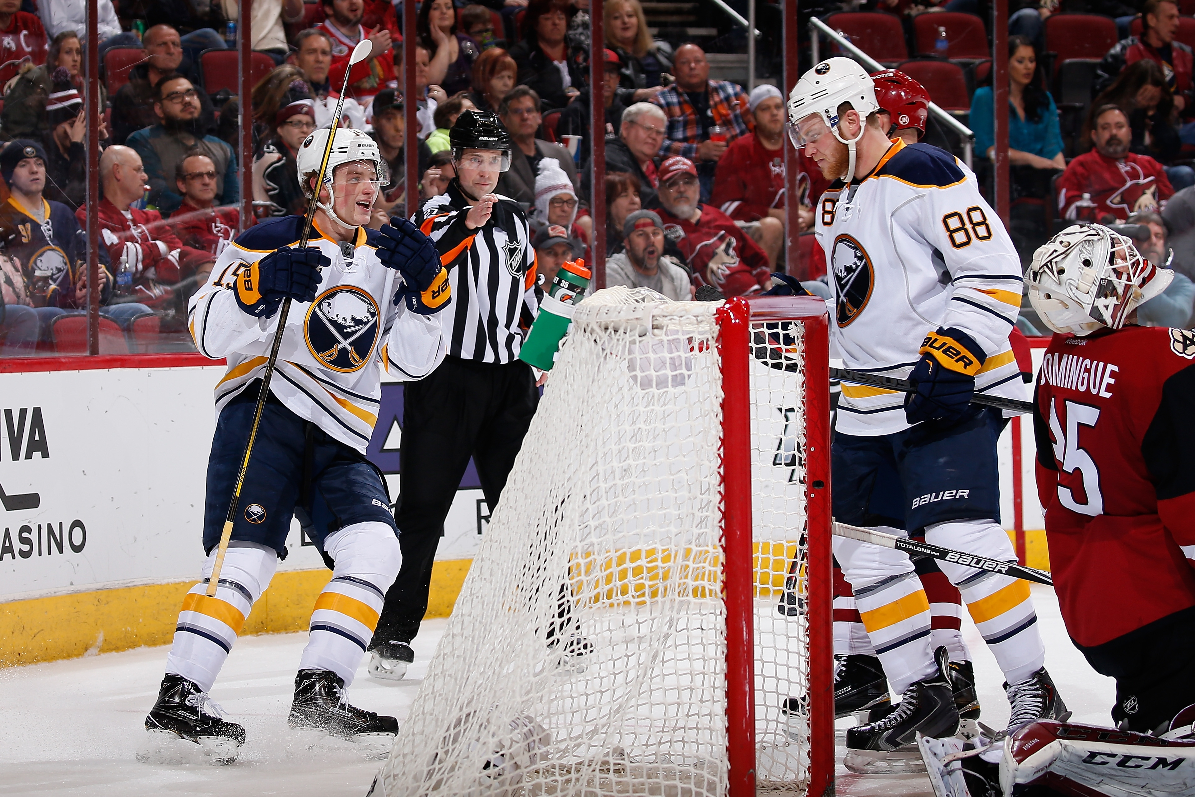 Jack Eichel, left, and Jamie McGinn celebrate after McGinn's power-play goal in Monday's victory over the Arizona Coyotes.