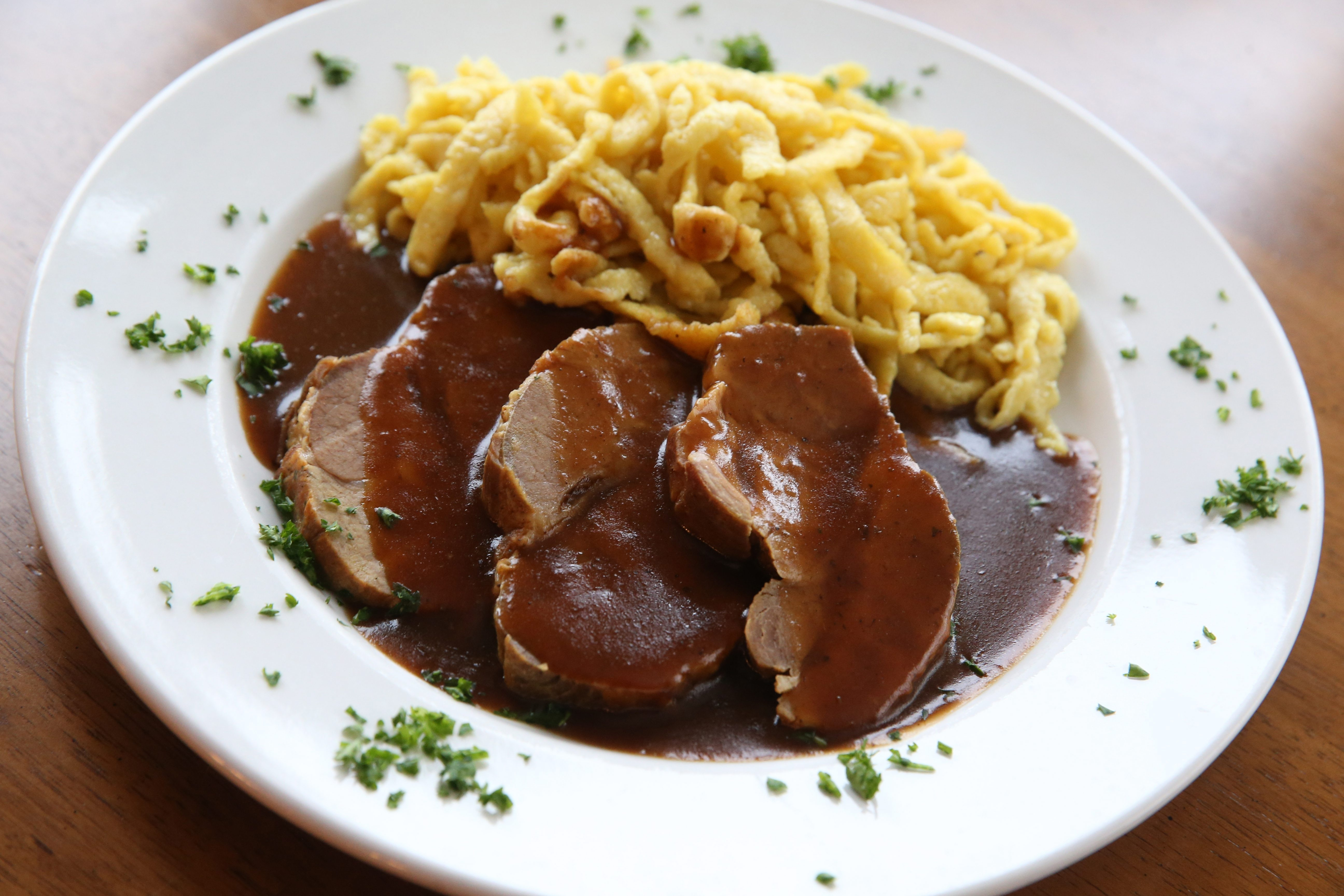 Pork comes in a dark beer gravy and is served with homemade spaetzle.