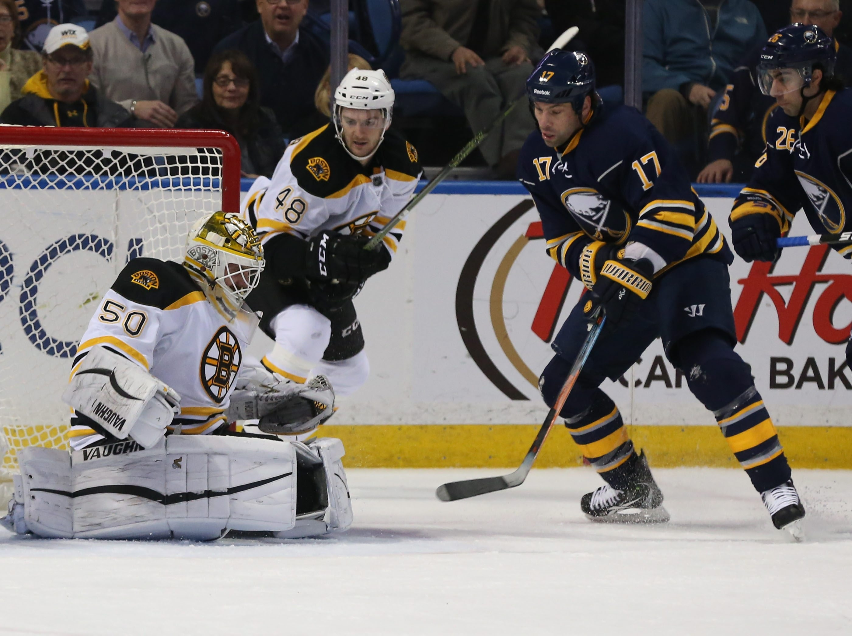 Buffalo's David Legwand scores the team's only goal in the first period against the Bruins Friday.